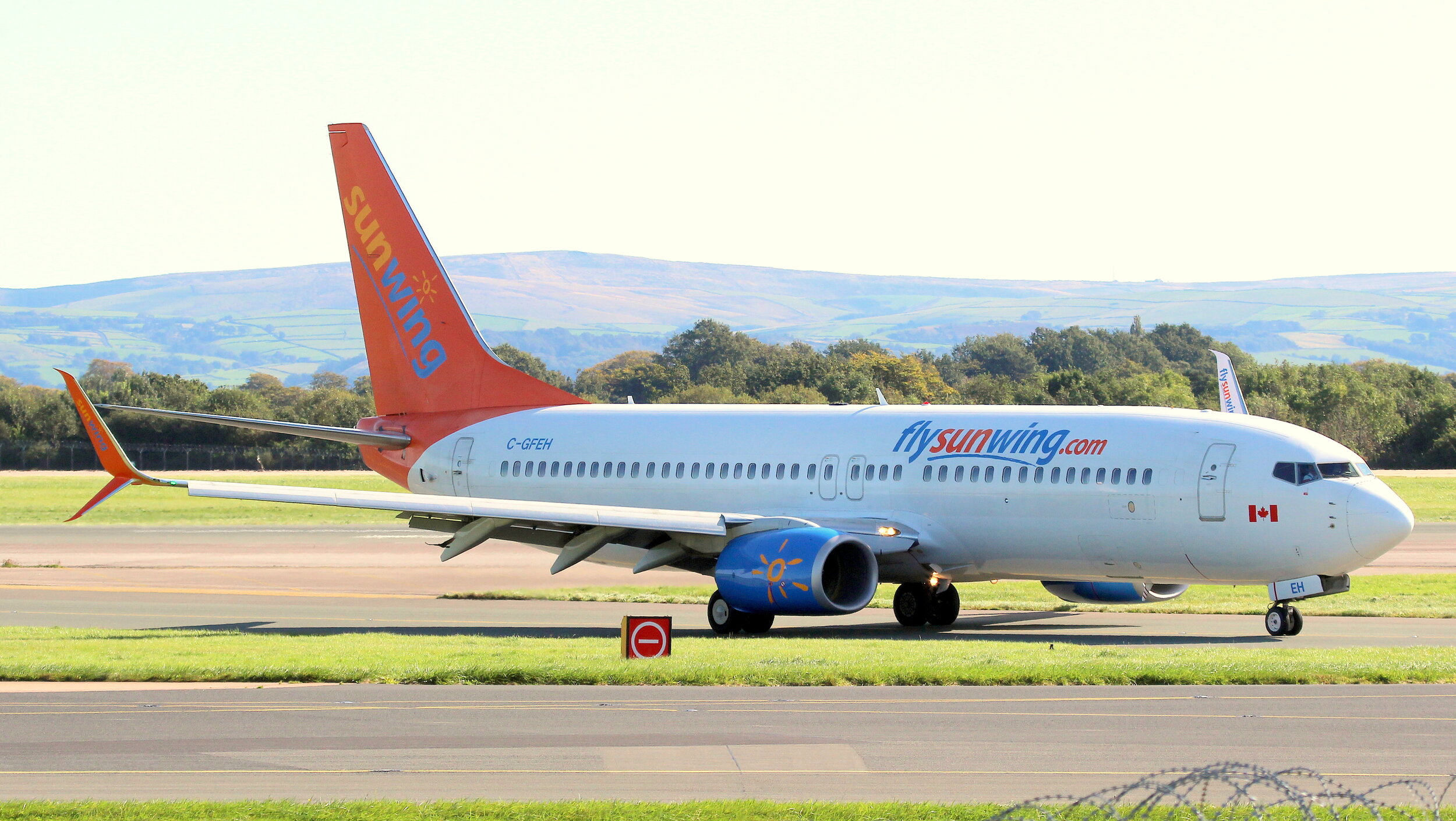 Sunwing B737-800 C-GFEH vacating Runway 23 Right on 2nd October 2019. Photo: Geoff Ball.