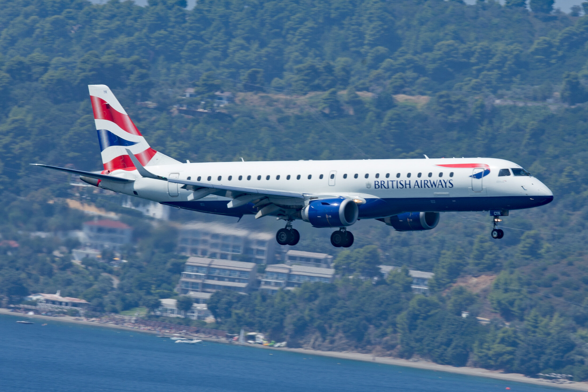 BA City Flyer Express operate the Embraer 190 on scheduled services from London City to Skiathos. The Kassandra Bay hotel can be seen behind the aircraft. Peter H