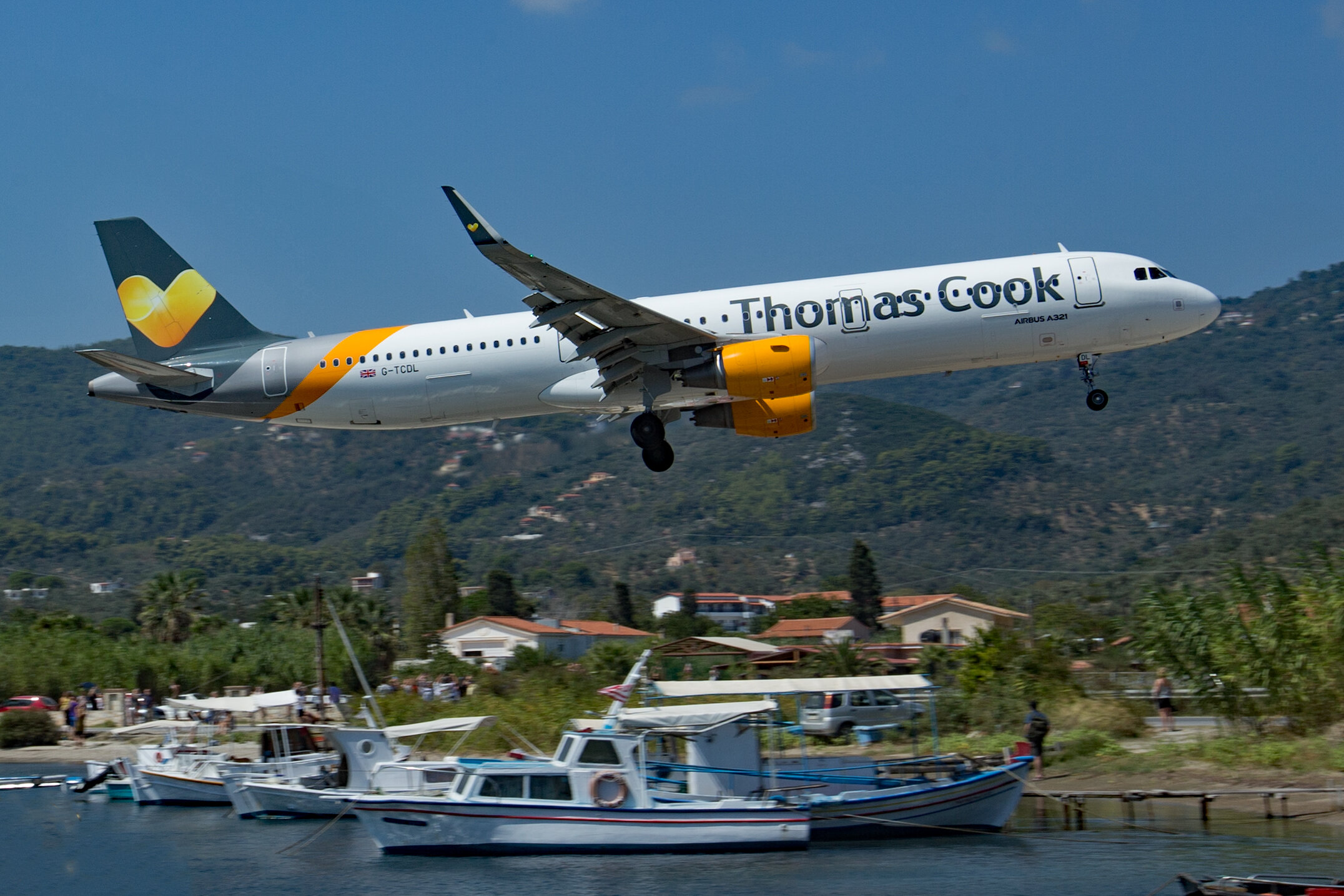 Thomas Cook A321 G-TCDL photographed from the harbour jetty. Peter H