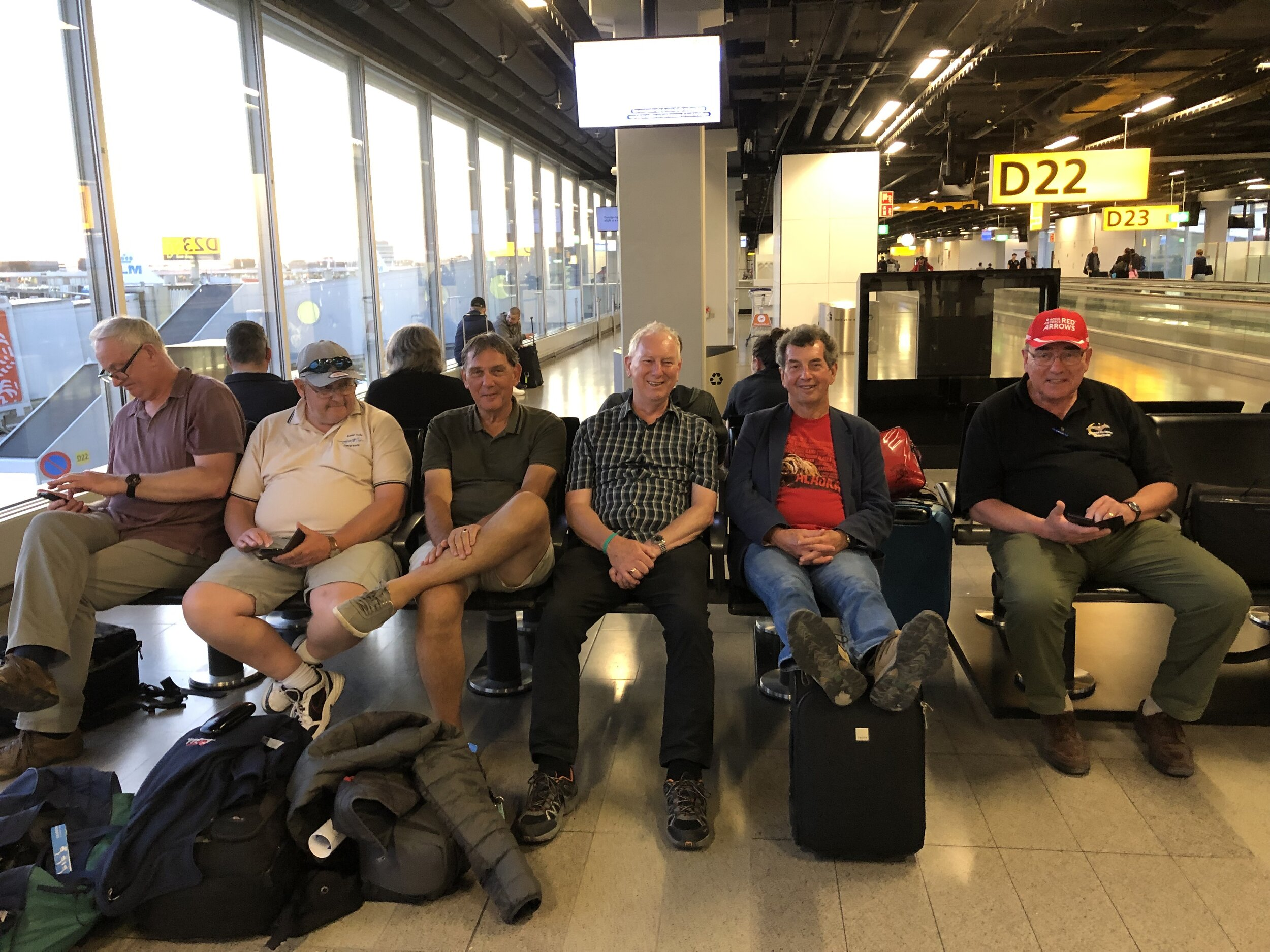 Toulouse Trippers awaiting flight connection in Amsterdam.