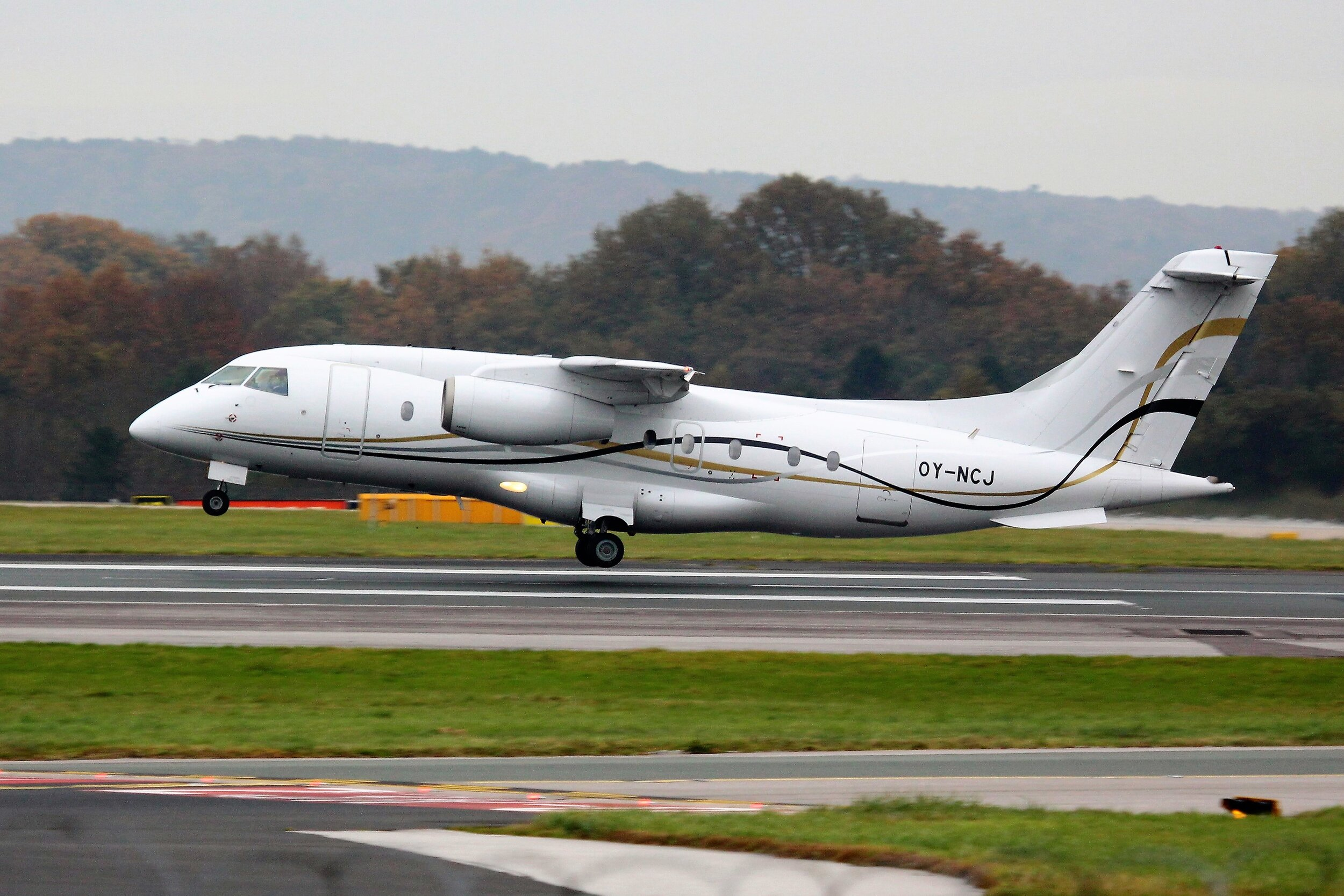 Do 228 jet OY-NCJ was photographed departing on Runway 05 Left (from the RVP) by Greg Mape on 6th November.