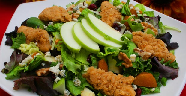 SOUTHERN FRIED CHICKEN SALAD  Diced chicken served over crisp greens with tomatoes, cucumber, onion and green peppers