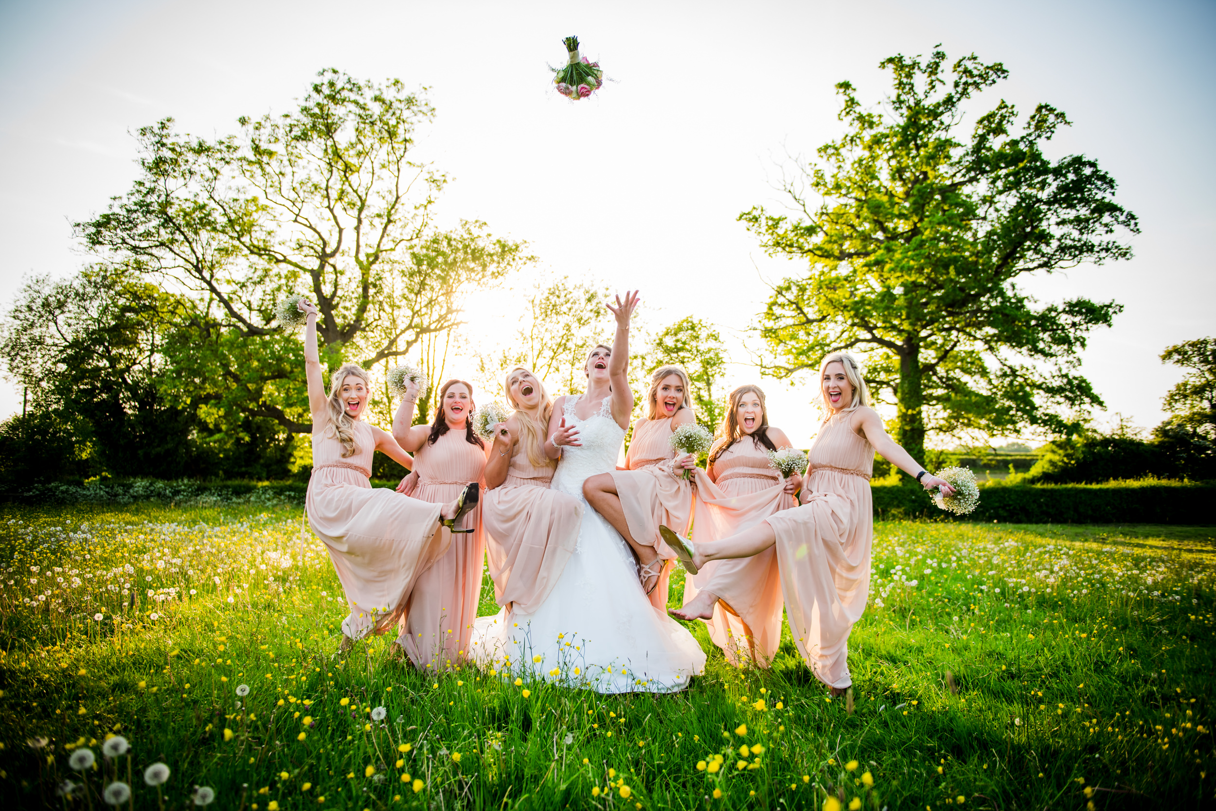 Bridesmaids group shot at Manor Hill House Worcs throwing the Wedding bouquet