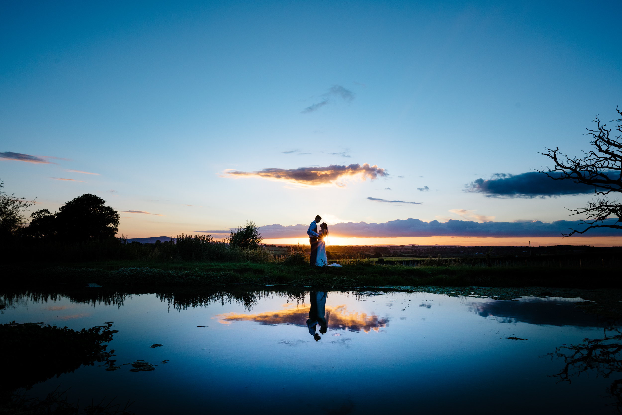 Sunset silhouette of a Bride and Groom at Deer Park Hall