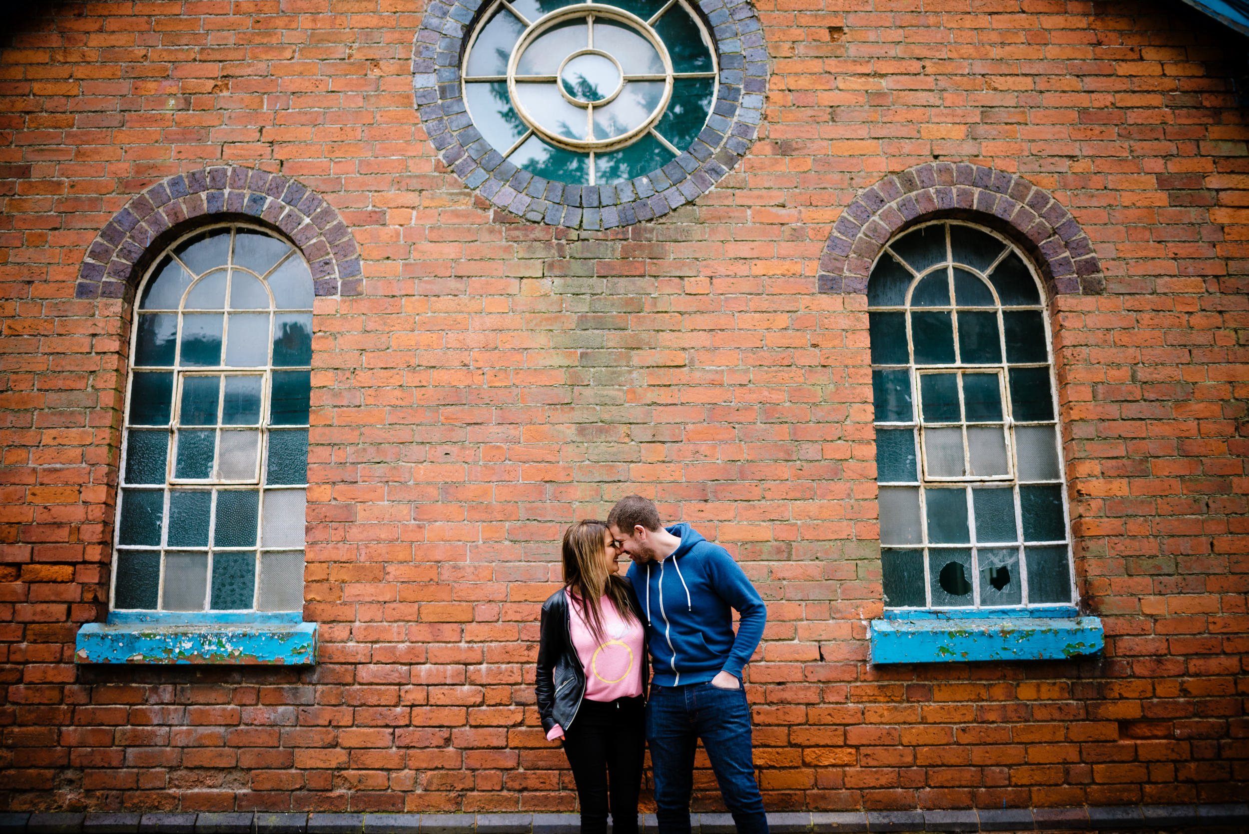 Relaxed couple having fun in front of an old building