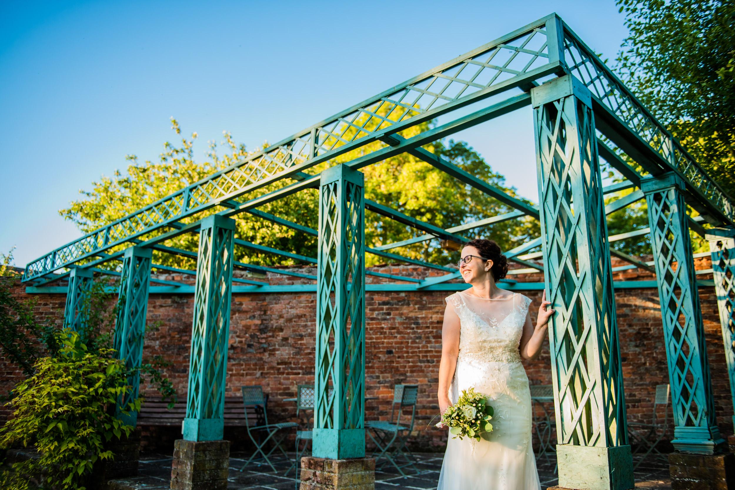 Bridal portrait outside in beautiful venue gardens