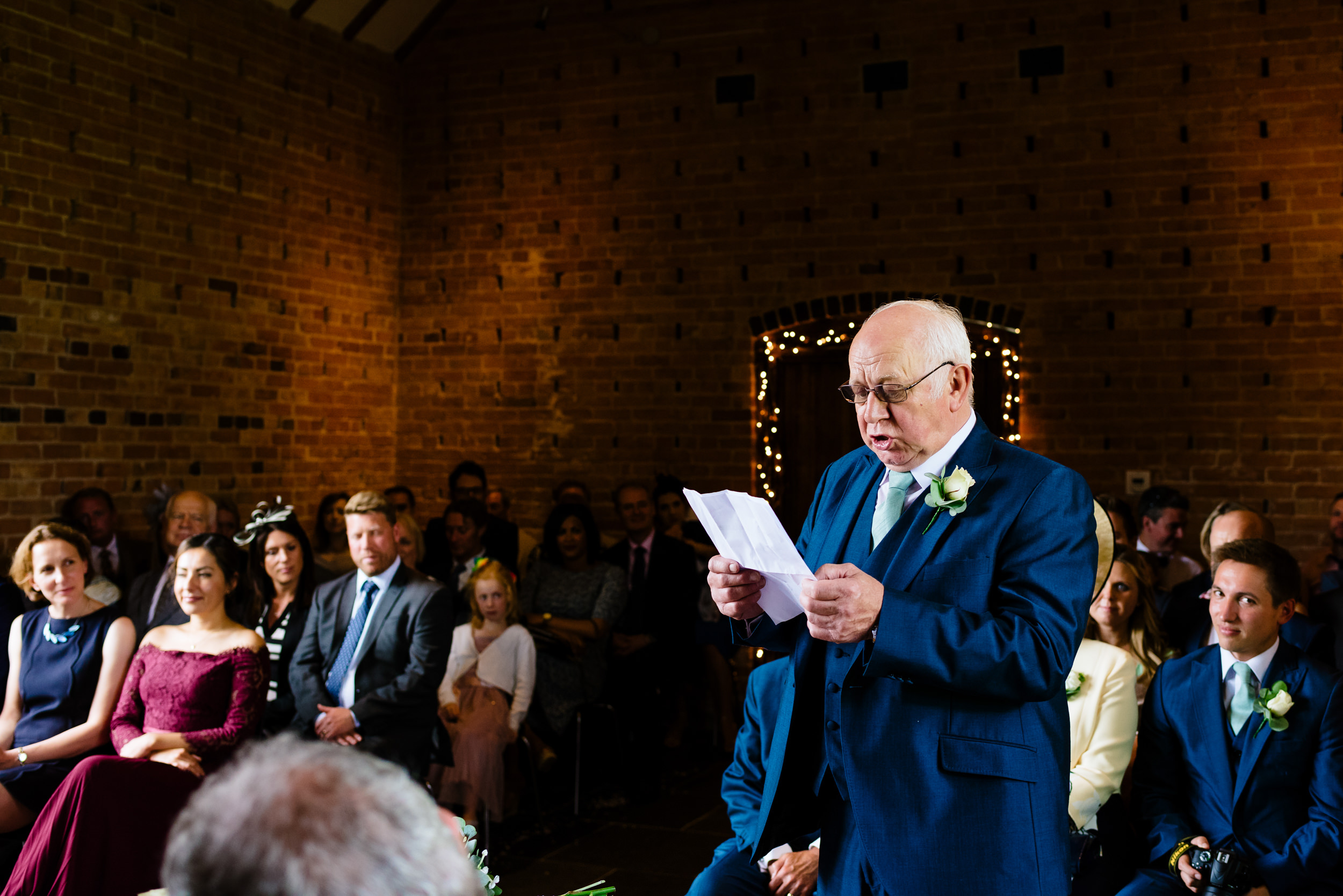 Father of the bride reading a speech at Red House Barn Worcs