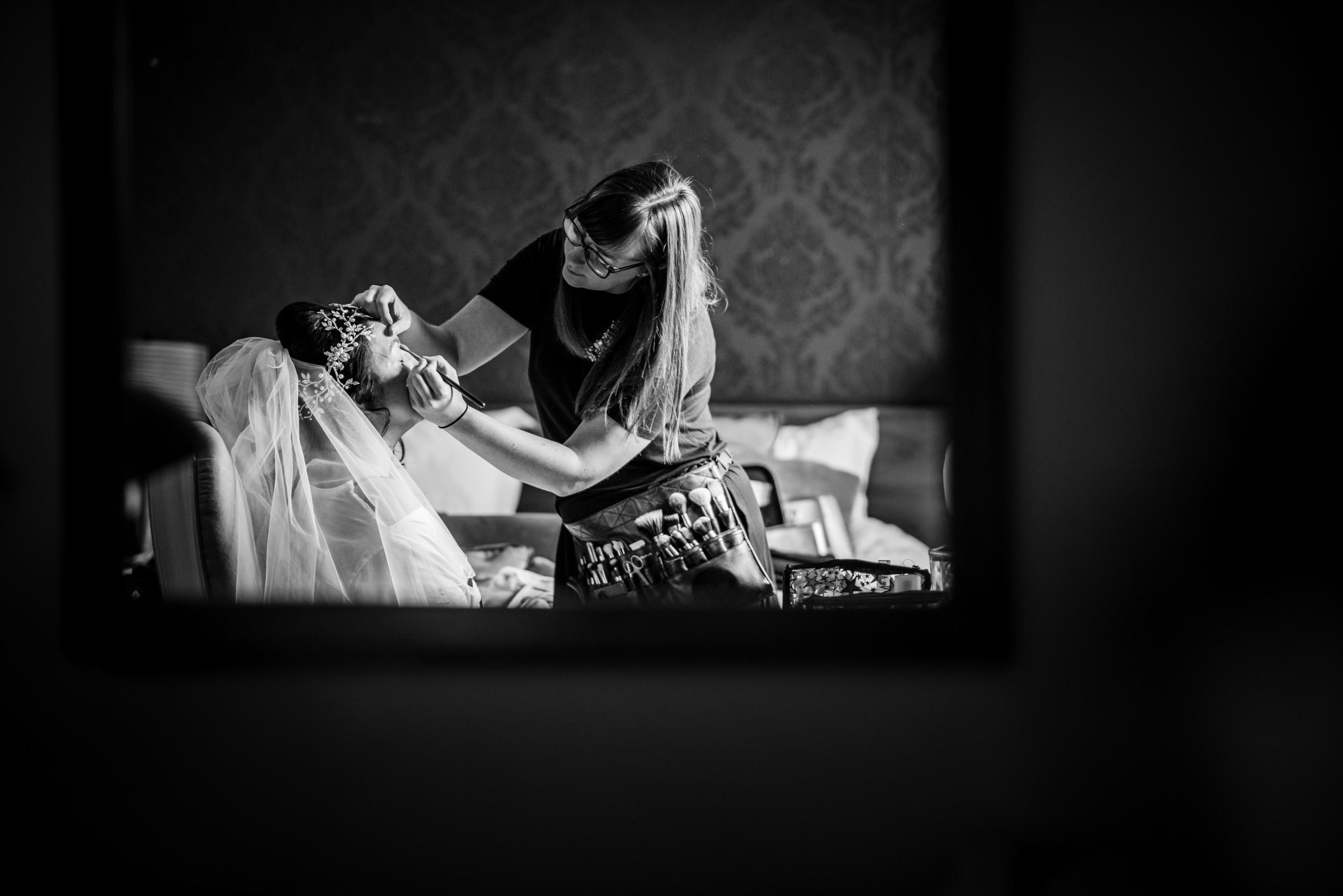 Make up artist doing Bridal preparations