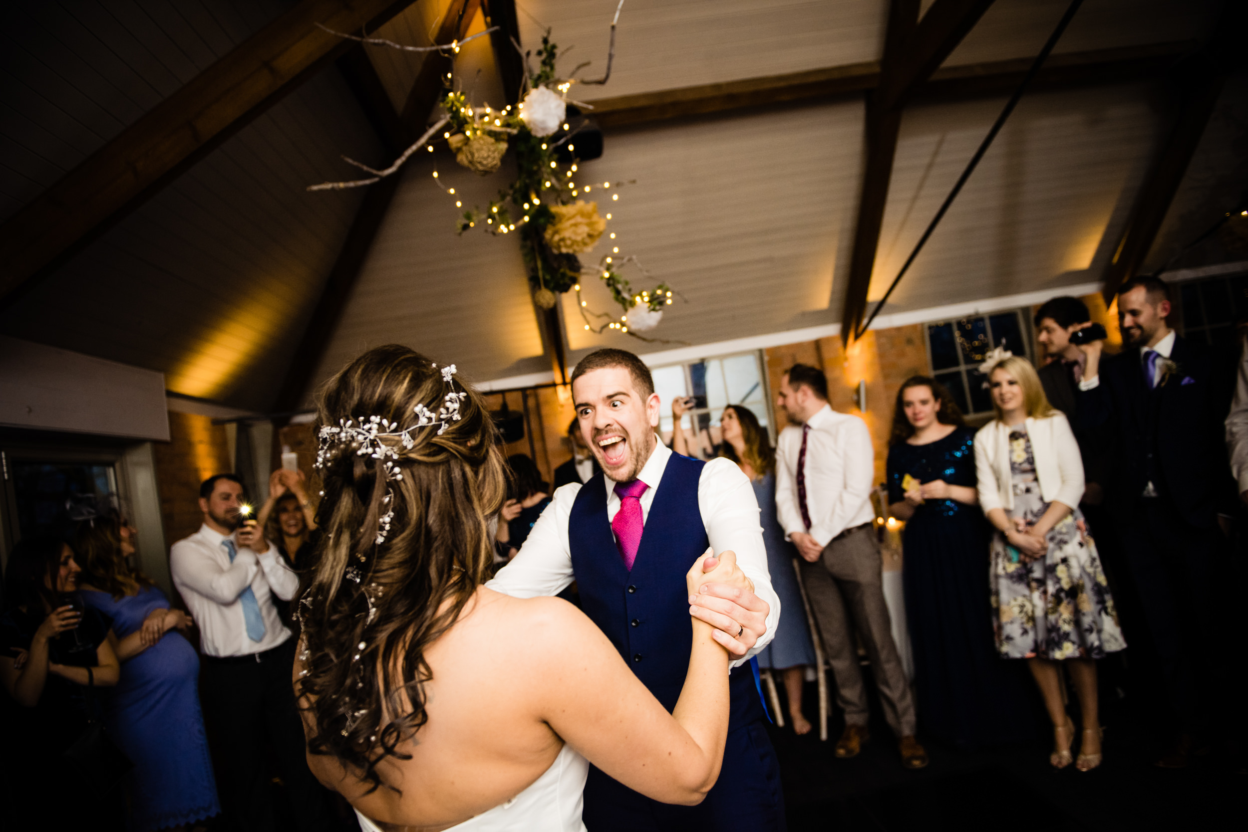 Groom dancing wildly with bride during Wedding First dance at Grafton Manor Redditch