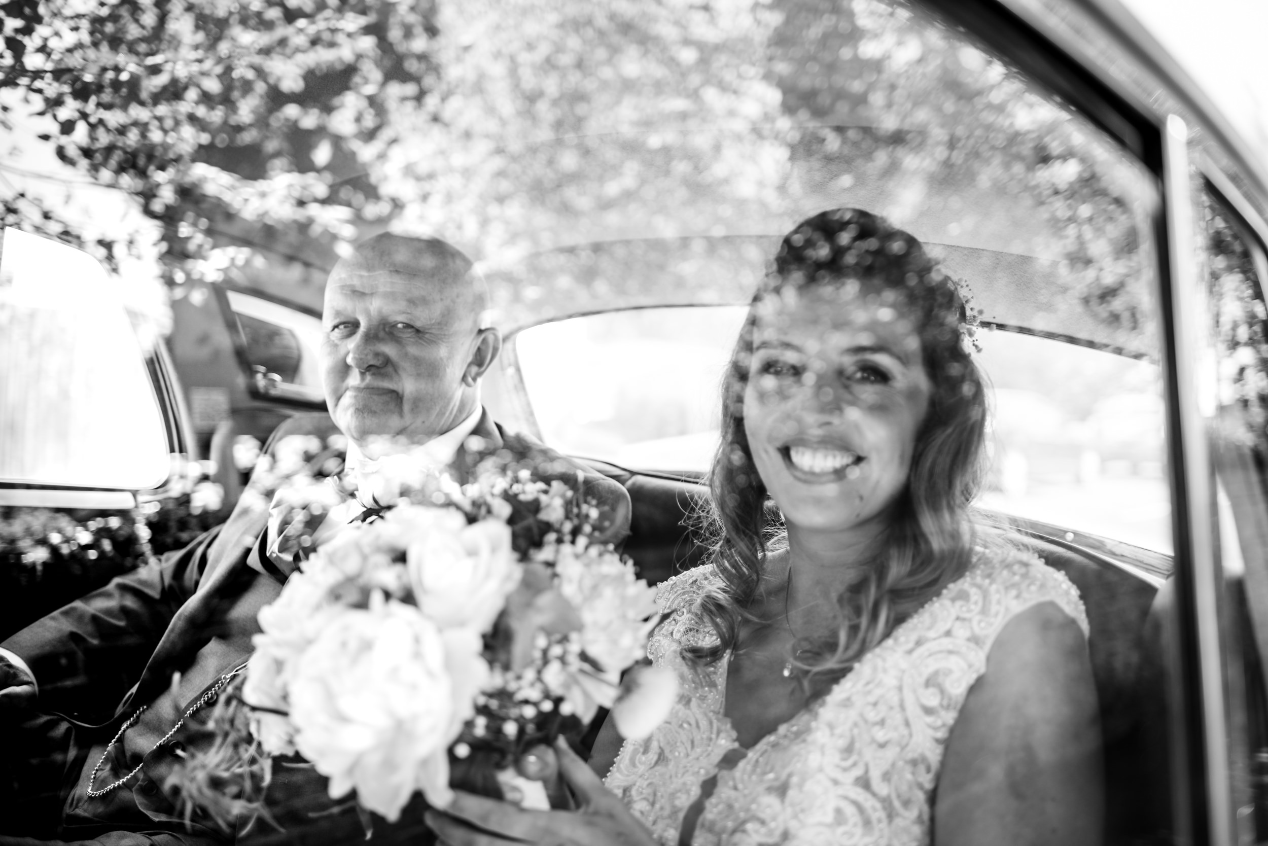 Father of the bride and bride in the Wedding car arriving at Church for the ceremony