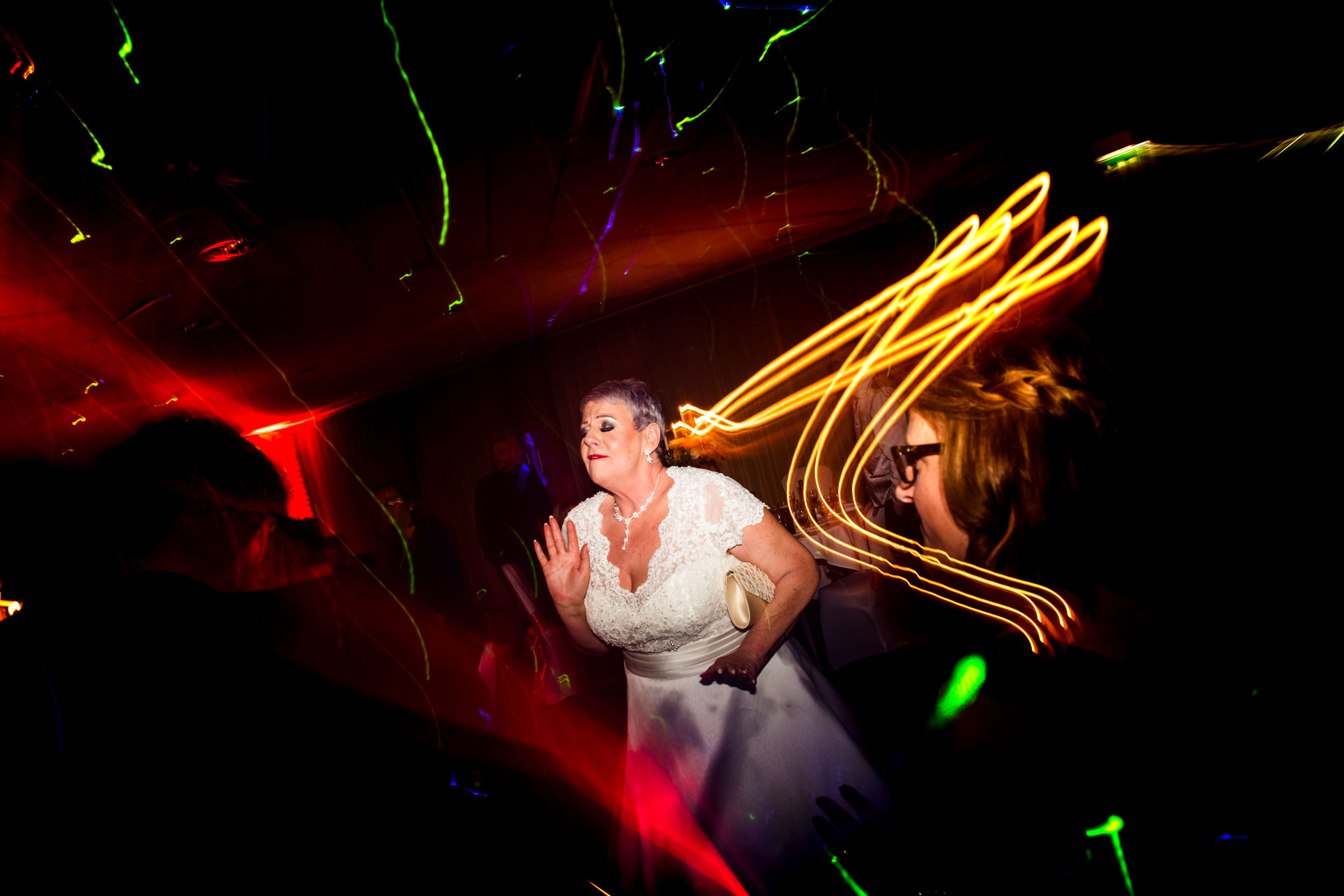 The Bride dancing wildly at the evening reception
