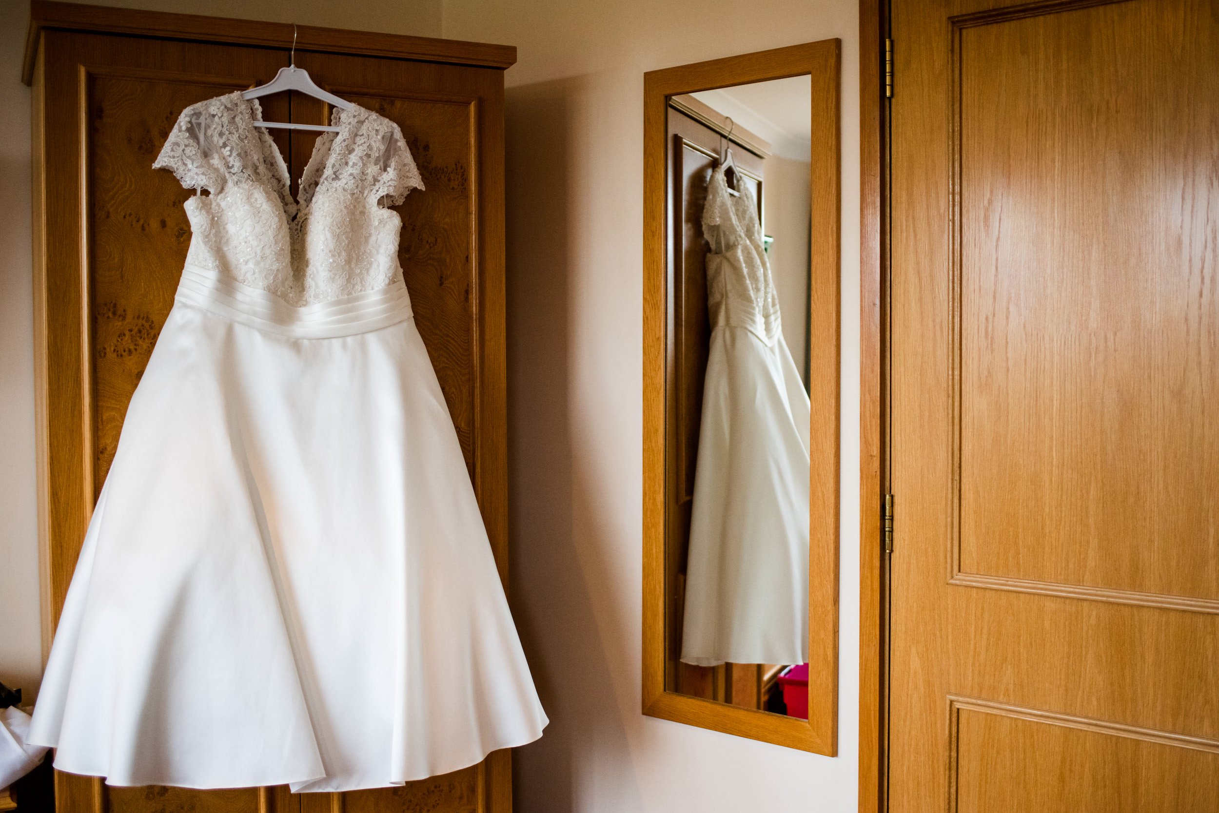 Wedding dress hanging on the wardrobe during Bridal preparations