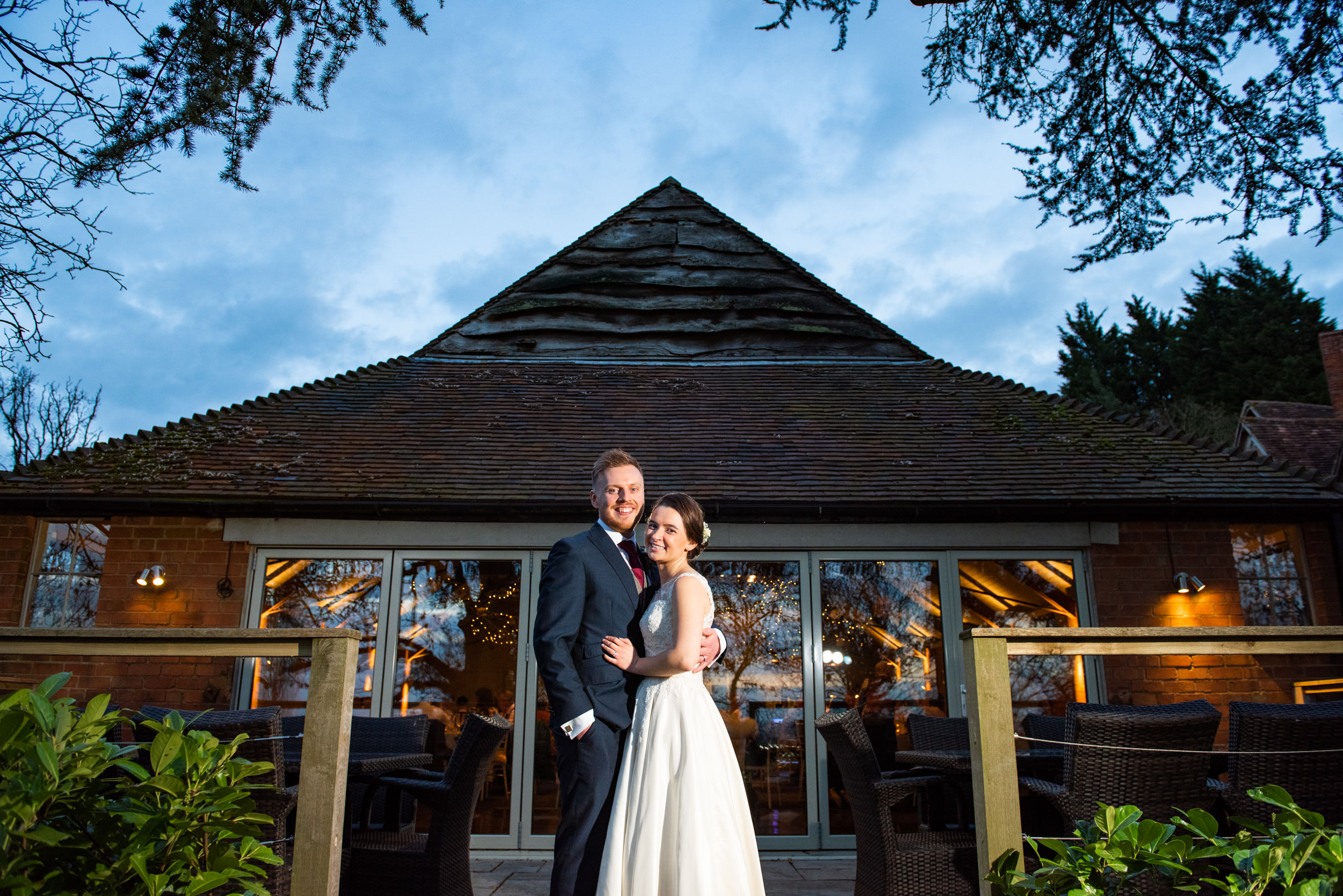Twilight portrait of the Newlyweds outside Gorcott Hall Reception barn