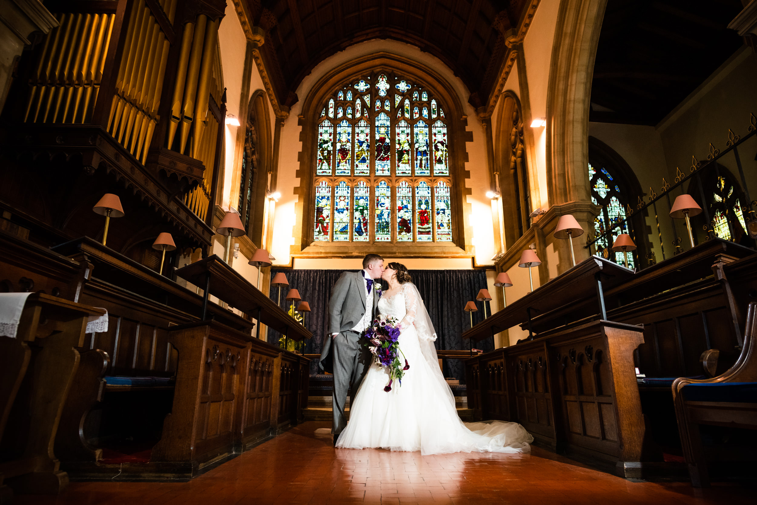 Newly wed couple kissing at the front of St Mary's Church, Stourbridge