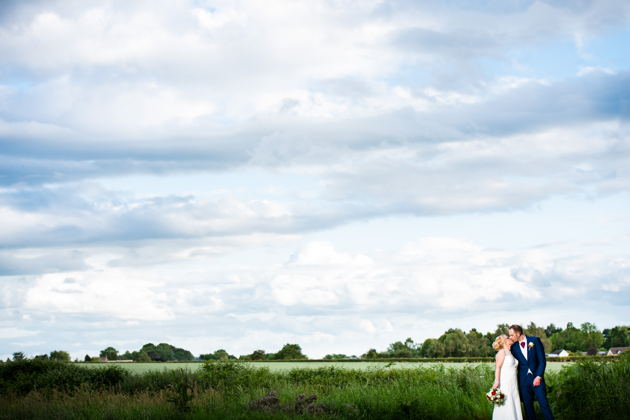 Bride and Groom kissing in front of the impressive view at Hogarths Stone Manor