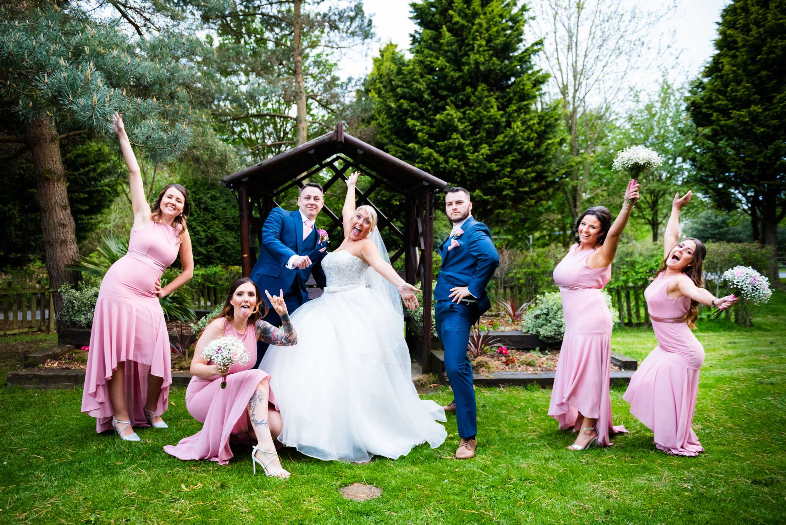 Bridal Party throwing silly poses in the gardens of the Abbey Hotel, Redditch