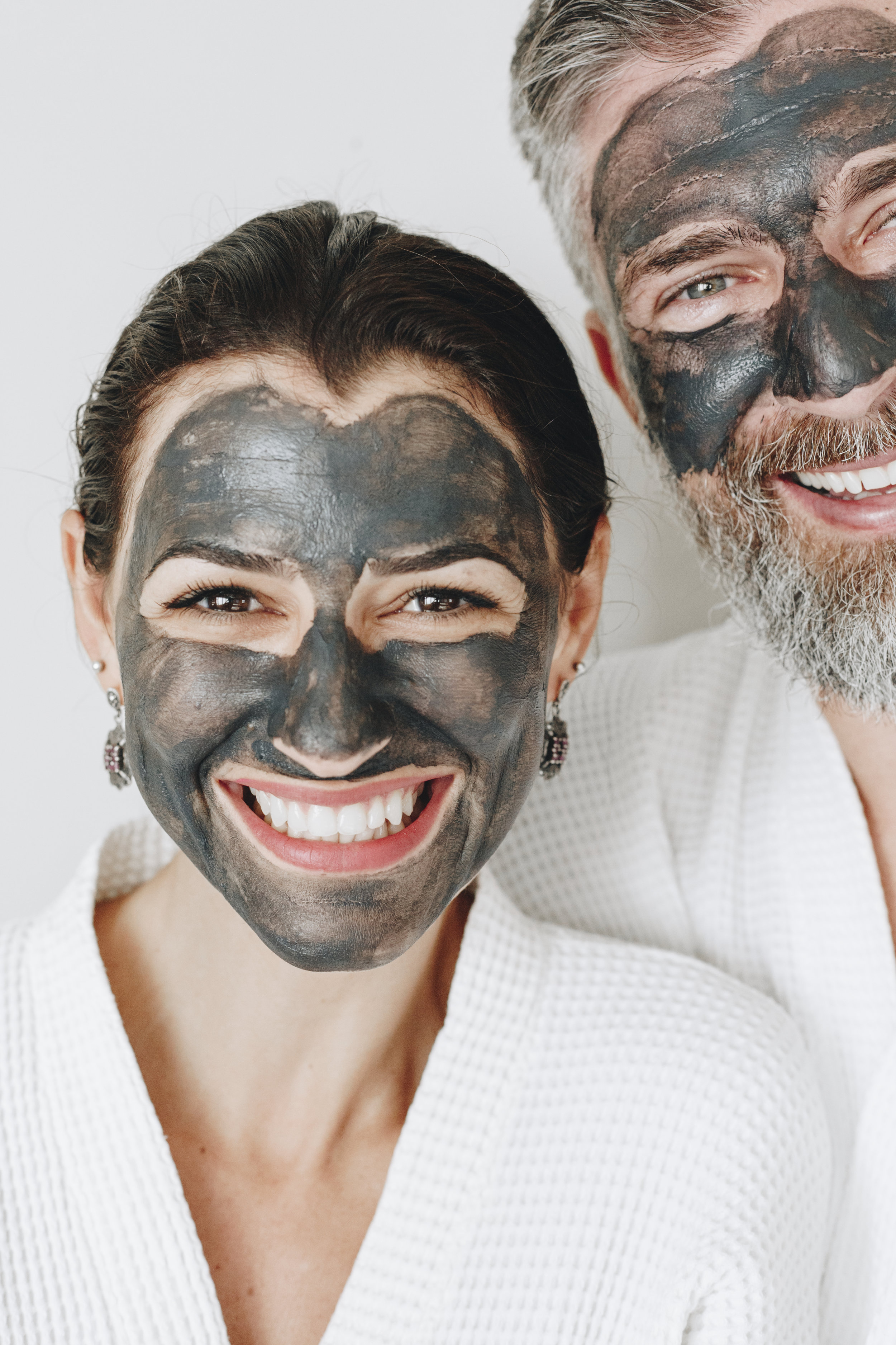 happy-couple-wearing-a-charcoal-mask-AXYBWQ9.jpg
