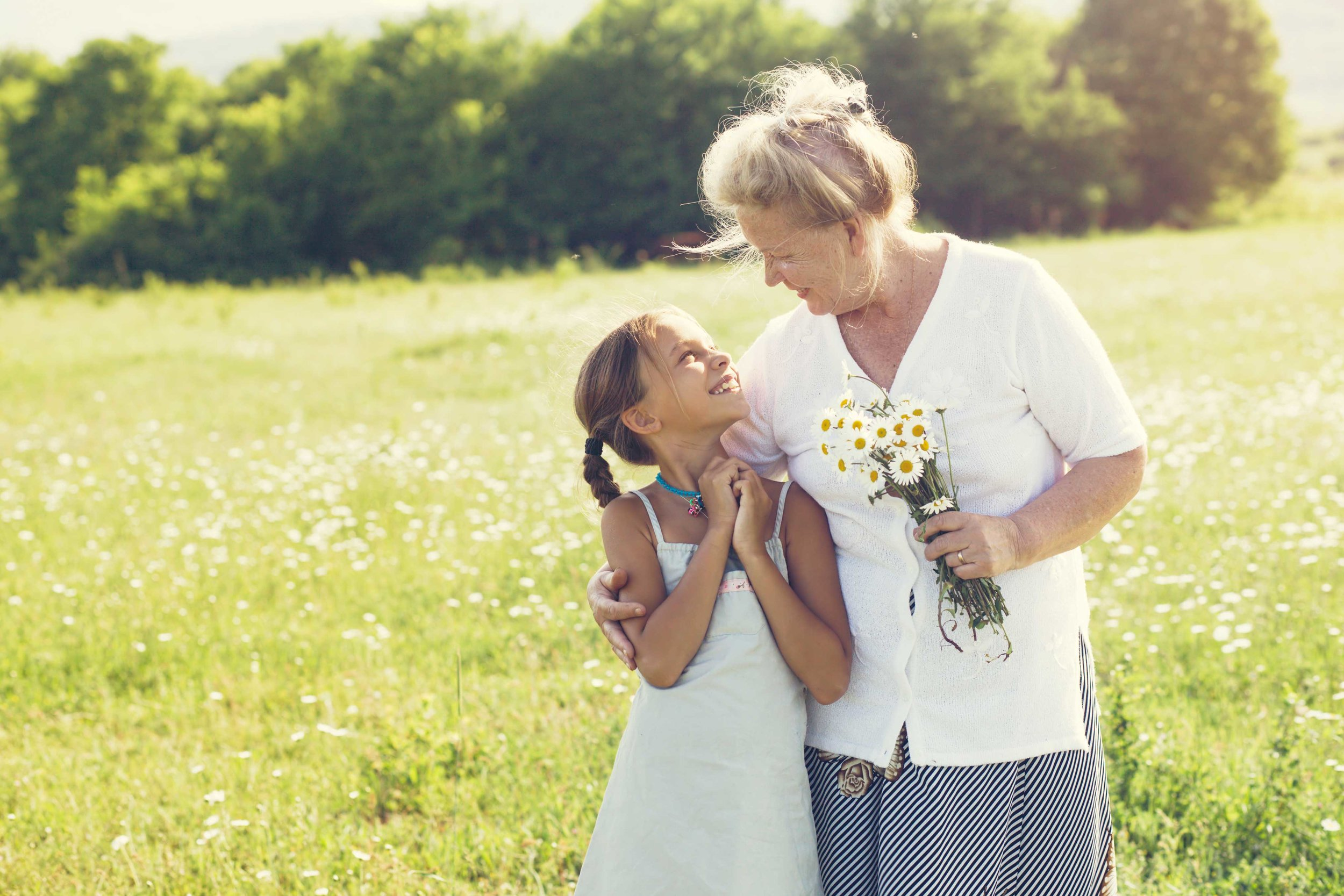 stock-photo-great-grandmother-and-granddaughter-standing-in-flower-field-in-sunlight-285328910_Med.jpg