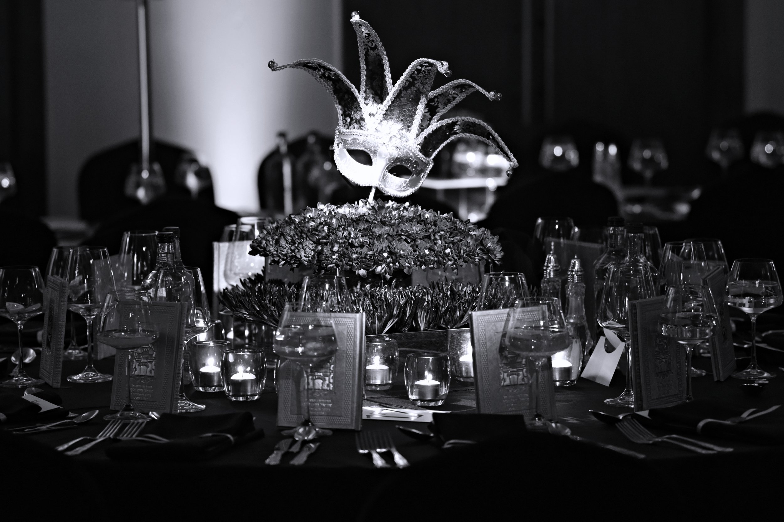 Gold masquerade centrepieces by Table Dressers adorned the banquet seating at The Kinloss Suite