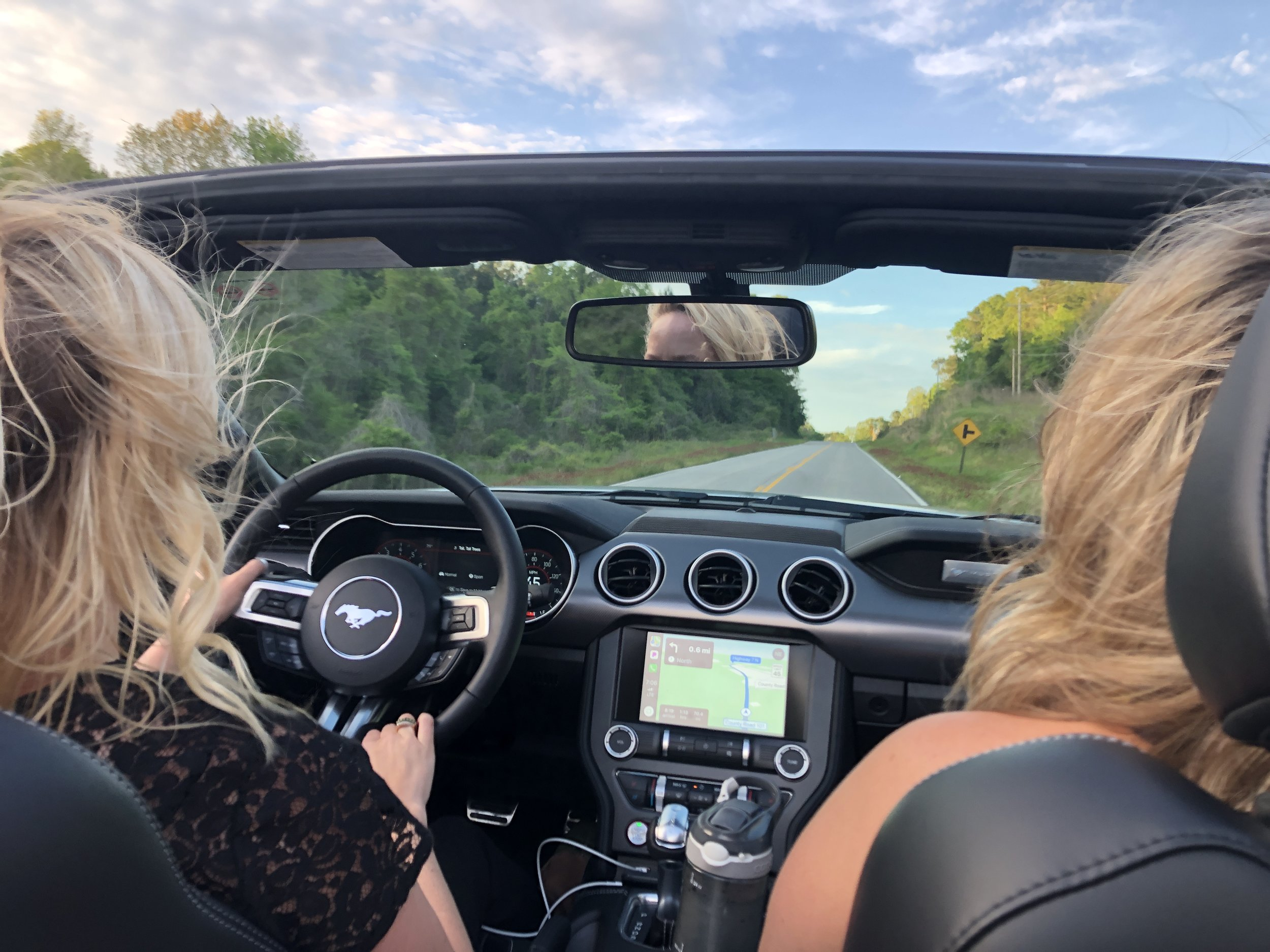 Driving on old country roads in our rental convertible!