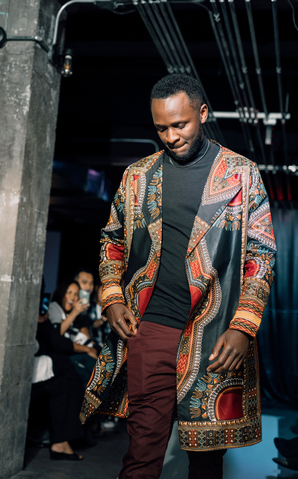 """ Sensation"" look 5 - DASHIKI COATBring out your inner African King with our custom-made African print long coat for menCan be worn for different occasions like weddings, dinner, prom & African themed eventsModeled by Ugandan model Peter KyosabaIG : @hunk__z"