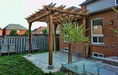 Pergola / Structures - We offer roofed (shingled) or unroofed structures of all shapes and sizes.  A pergola can create a great space over a patio or deck.