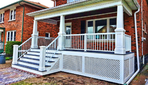 Front Porches - We build front porches from all types of materials including top quality composites and PVC.  Seen here are PVC columns and skirting, composite decking and aluminum railings.