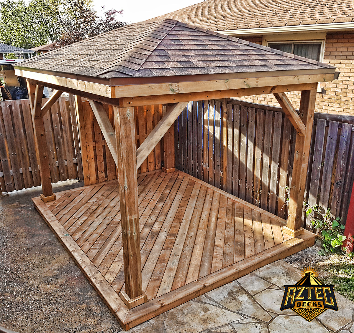 Oshawa deck with shinged roof gazebo made of pressure treated wood