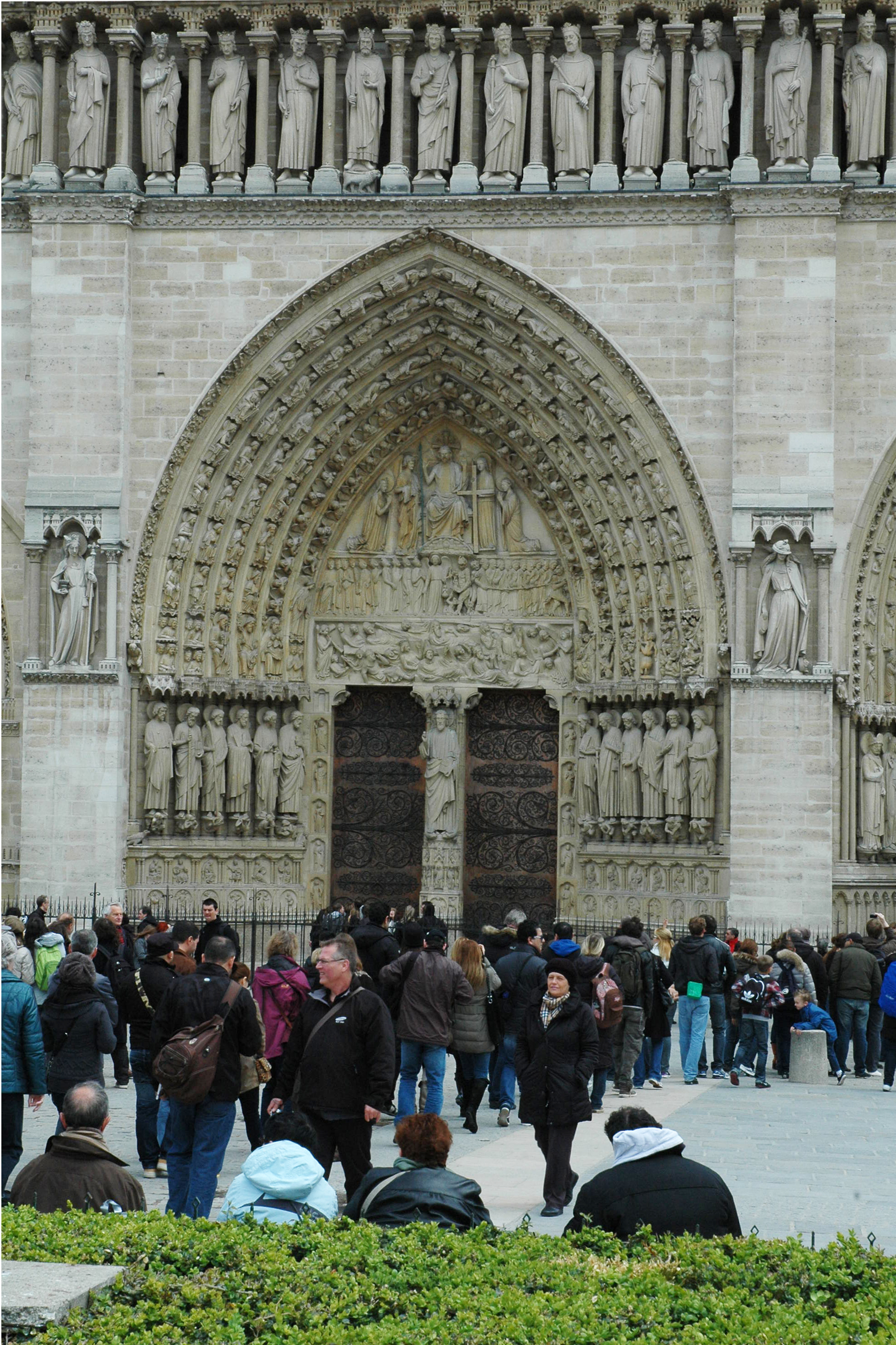 Notre Dame west entrance doors,    tympanum    and arch taken in better days. Paris is a treasure of the world.