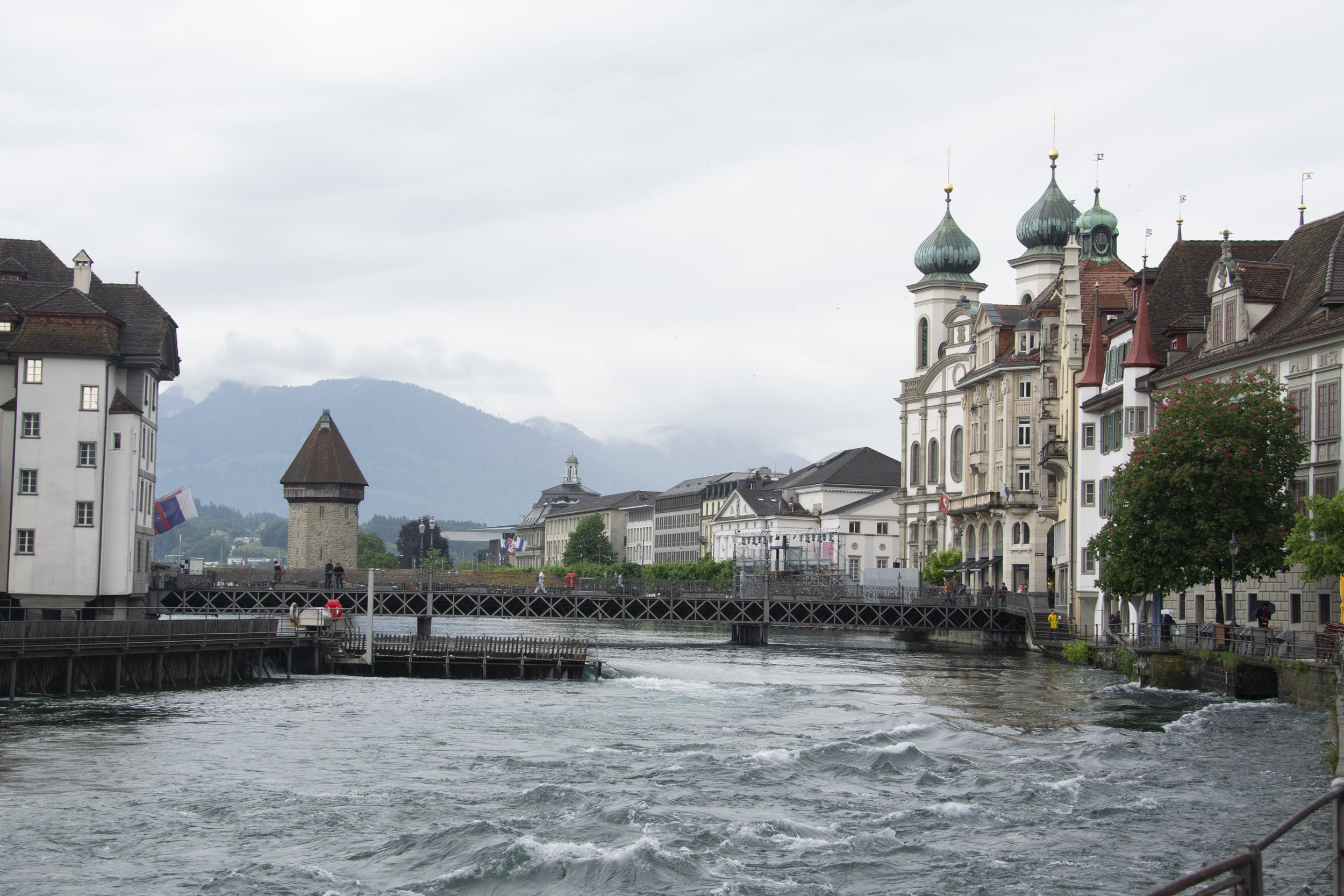 Limmat River, Luzerne   The medieval bridge in mid-ground spans the Limmat River. An Orthodox church with onion-domes lies further back. Still no sun.