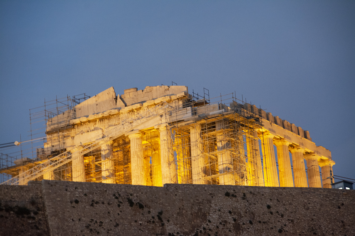 Parthenon Evening   The telephoto shot foreshortens the view, making the tall face of the retaining wall appear to be next to the Parthenon, although it's well away from it. This was one of the photos I lost from one digital card; the second card hadn't been corrupted. Let that be a lesson.