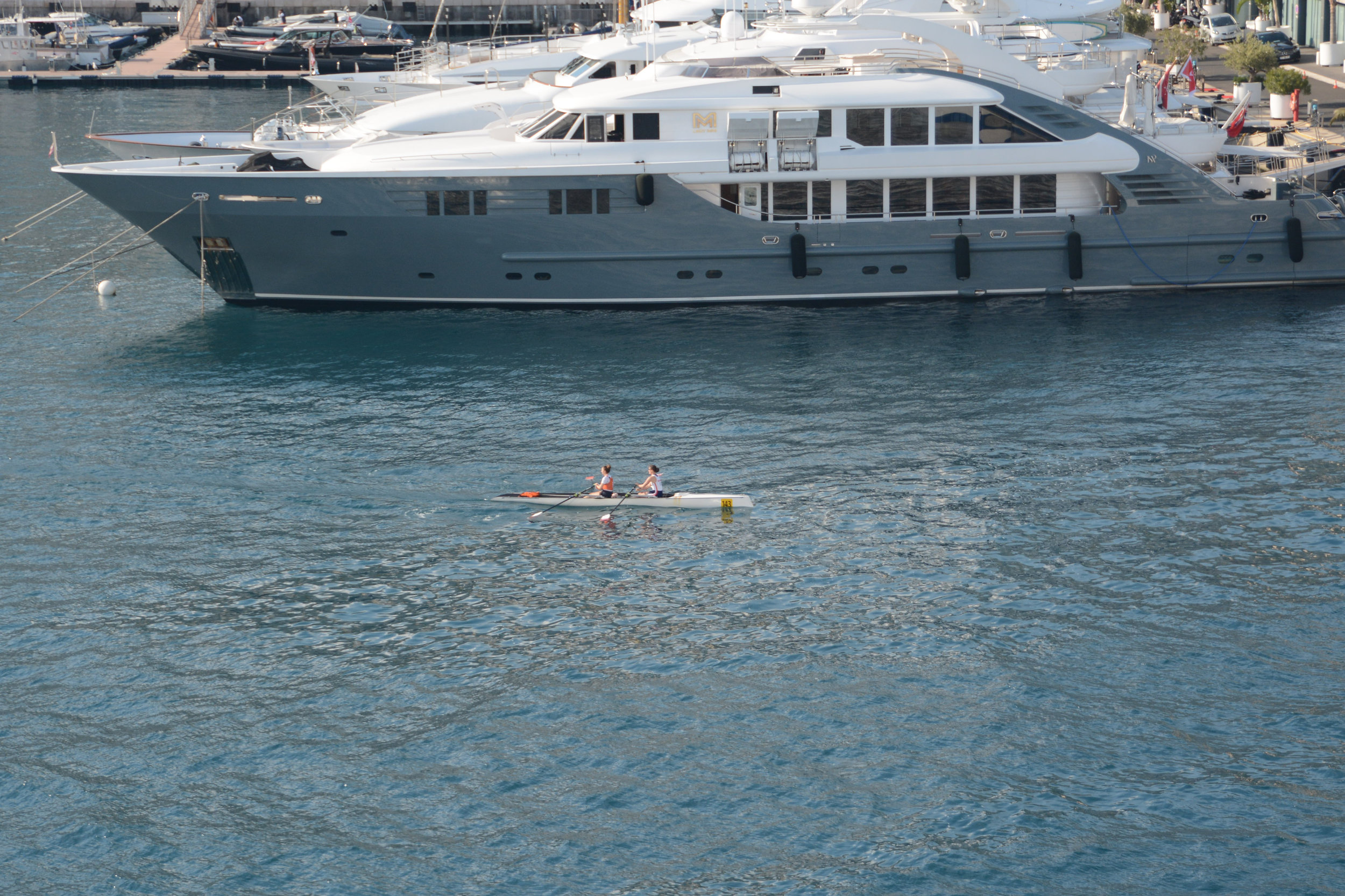 A two-woman shell in the harbor at Monte Carlo.  The ridiculous shift in scale and purpose caught my eye.