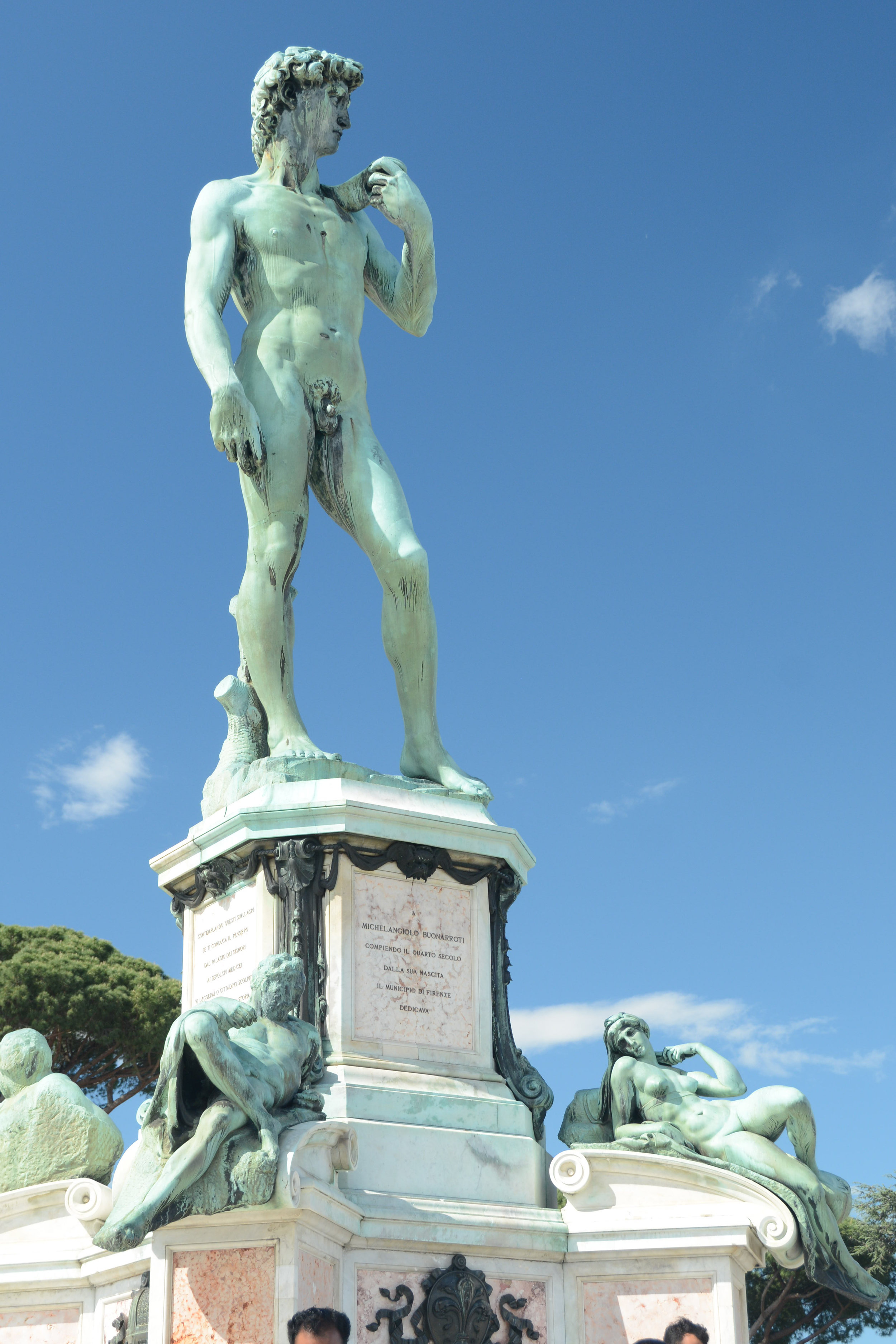Replica of David with some lounging ladies in Michelangelo Square where the tour buses gather.