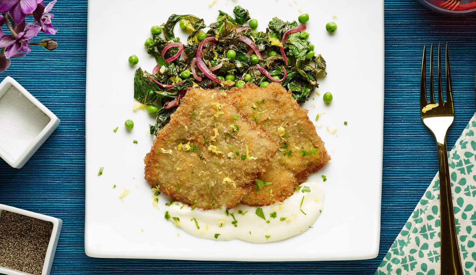 veal medallions over a pea salad with lemon juice