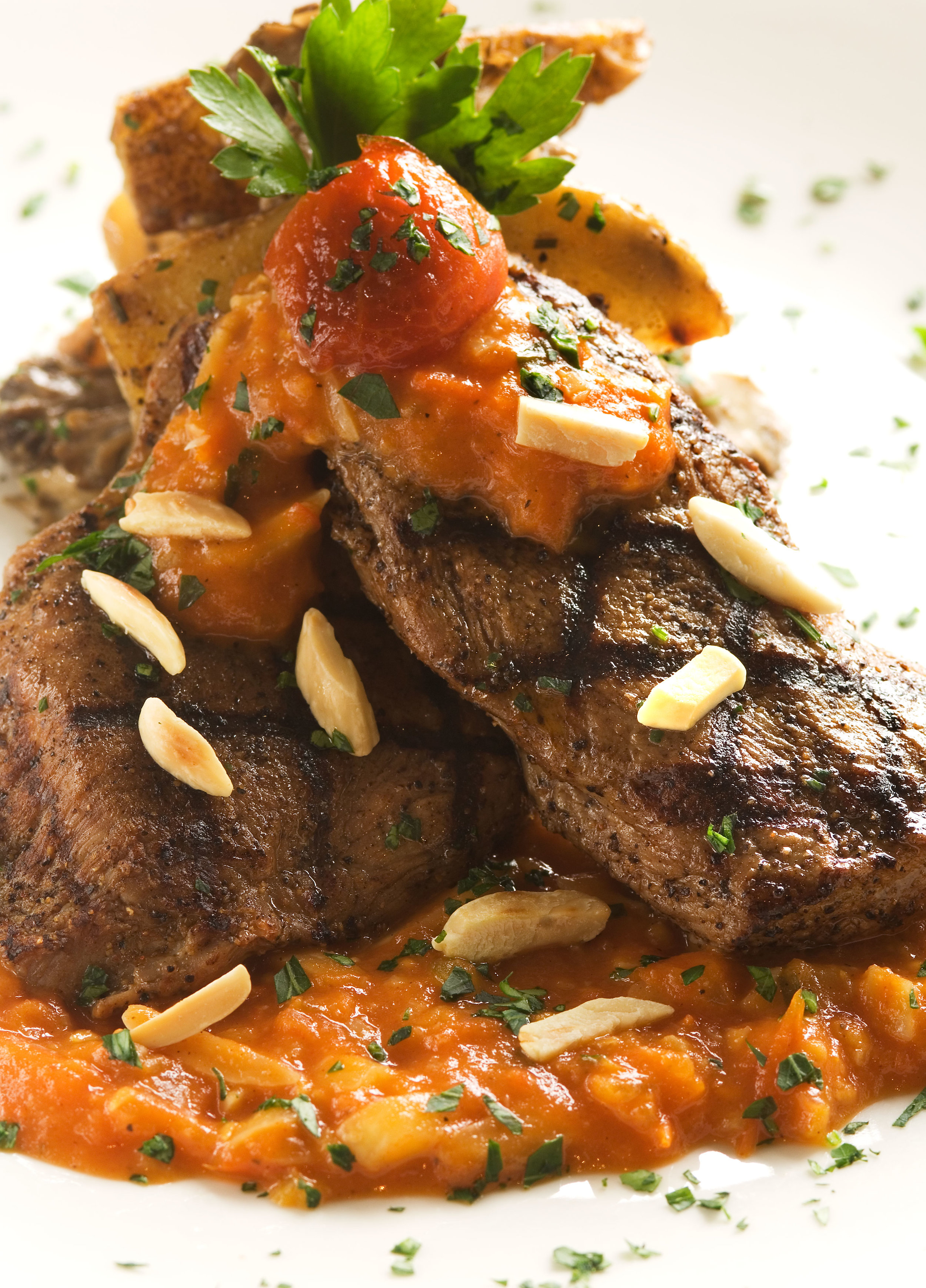 sweet_and_spicy_veal_romesco_with_maitake_potato_medley.jpg