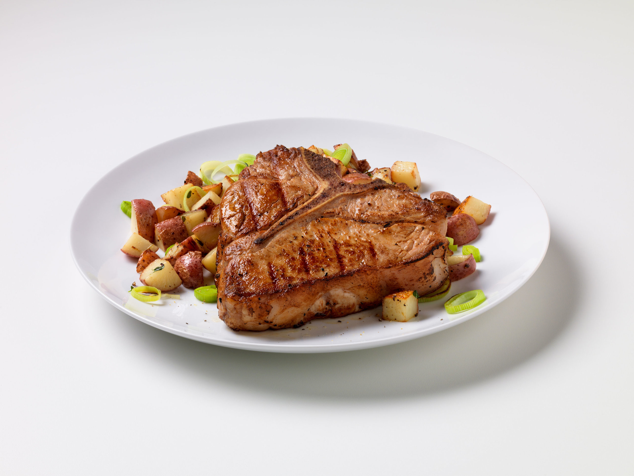 Grilled Veal Chop with Potato Leek Hash