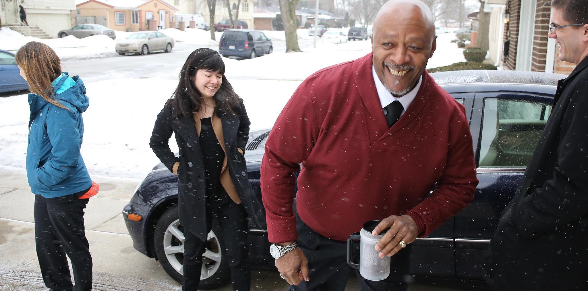 Getting ready for court with exoneree Tyrone Hood. [Photo Courtesy of Antonio Perez, Chicago Tribune]