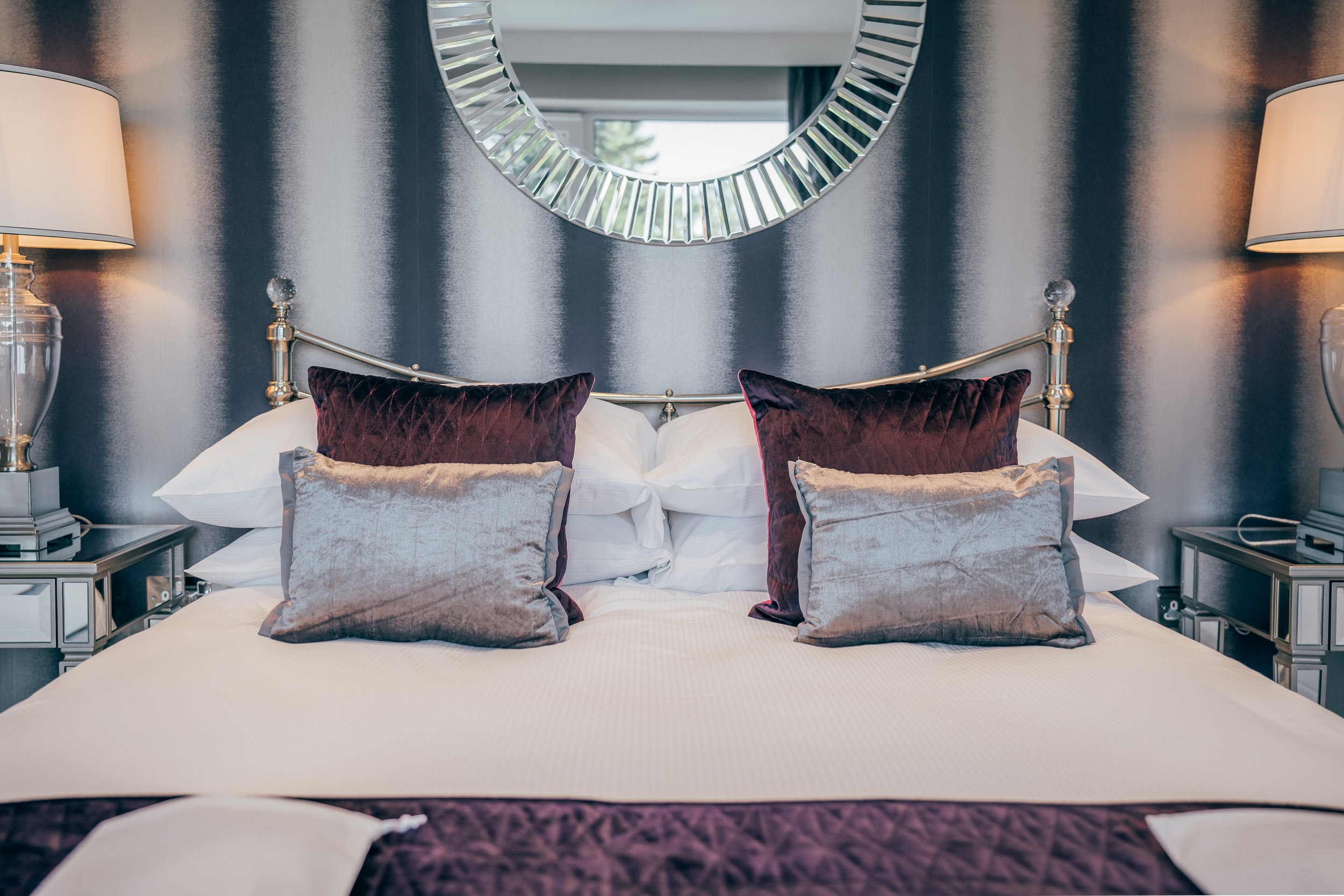 Crisp white bed linens and sleep essence