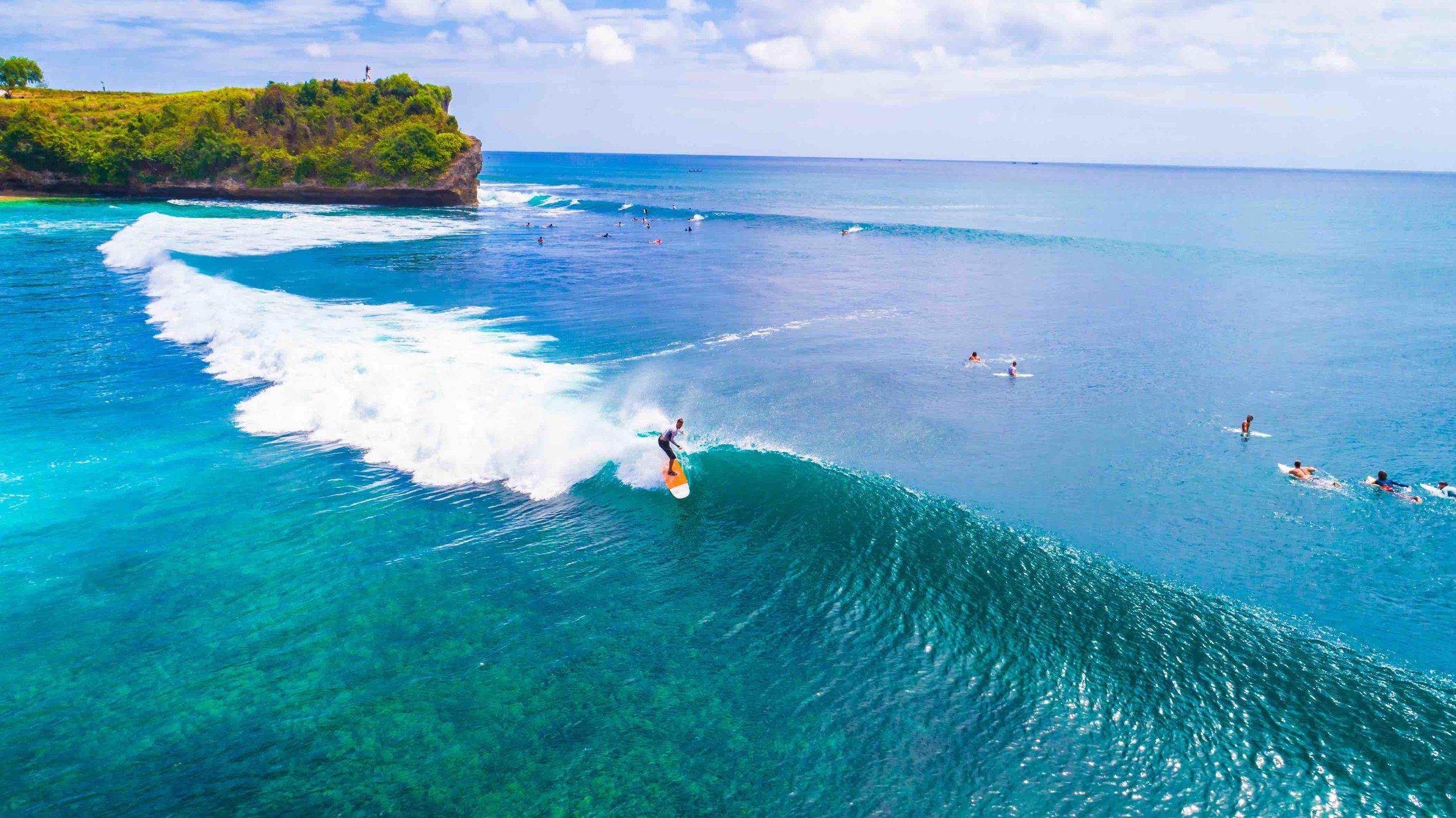 Surfing the breaks of Balangan Beach, Bali