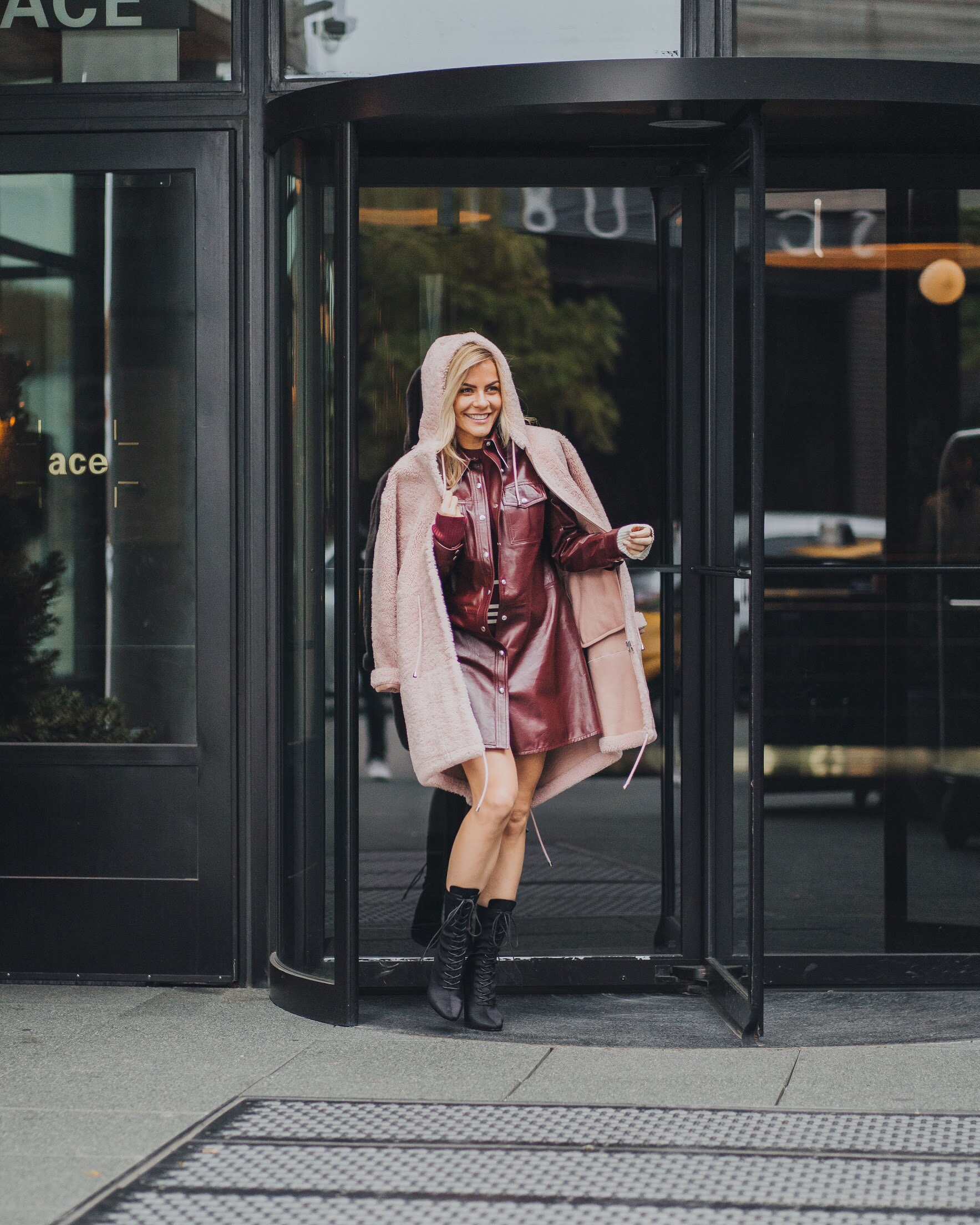 Monika Dixon of Monika Dixon Public Relations is wearing a Calvin Klein sweater under a Calvin Klein leather dress paired with an Anne Vest jacket.