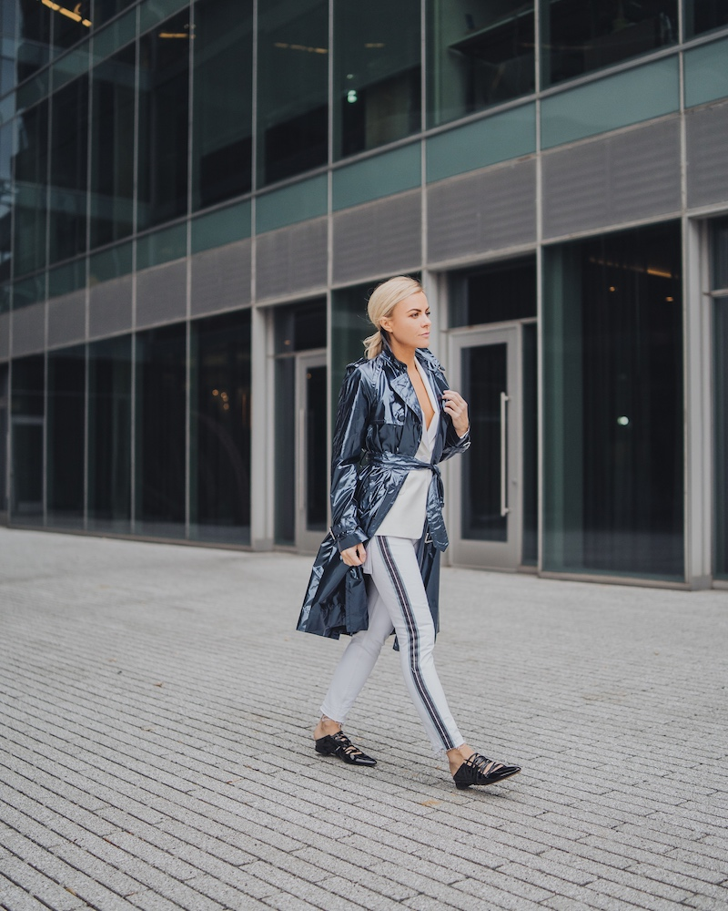 Monika Dixon of Monika Dixon Public Relations is wearing Grlfrnd jeans paired with a white Helmut Lang blazer and Marc Jacobs trench coat.