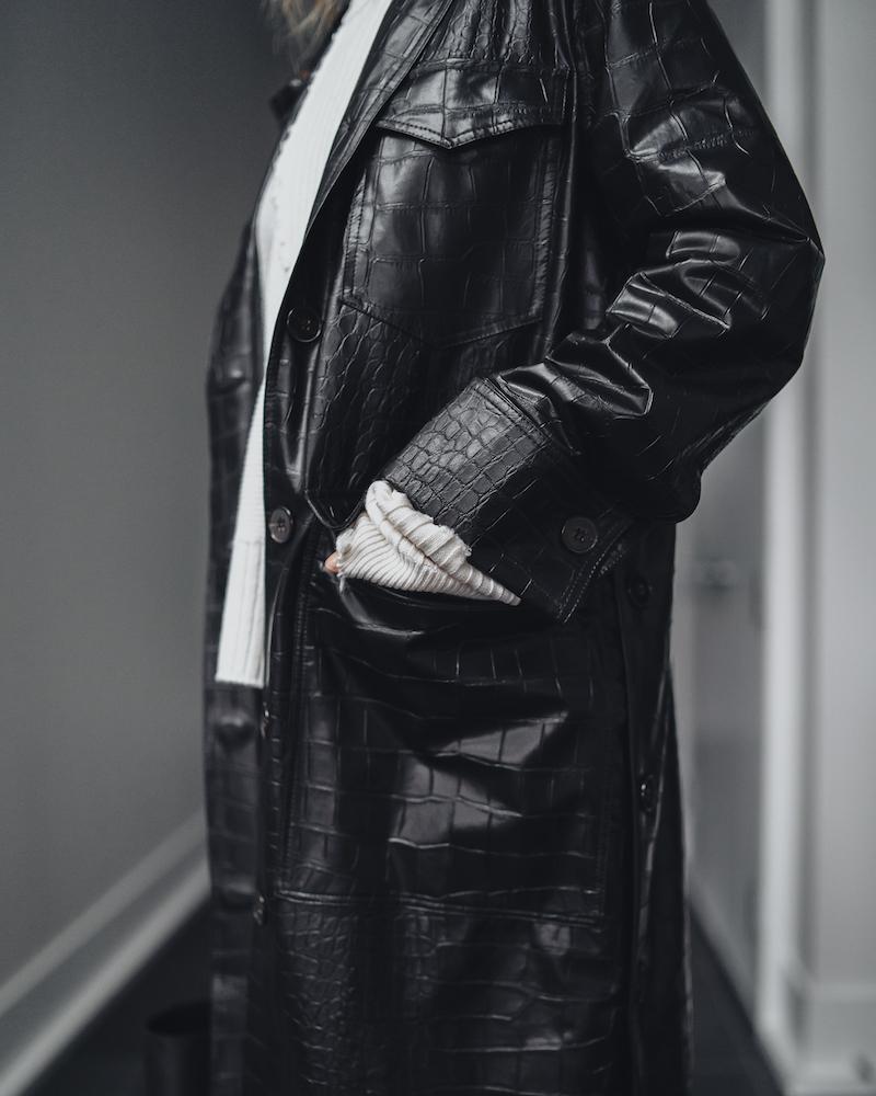 Monika Dixon of Monika Dixon Public Relations is wearing a faux, crocodile Nanushka jacket with a Helmut Lang Sweater and Maison Margiela MM6 pants.