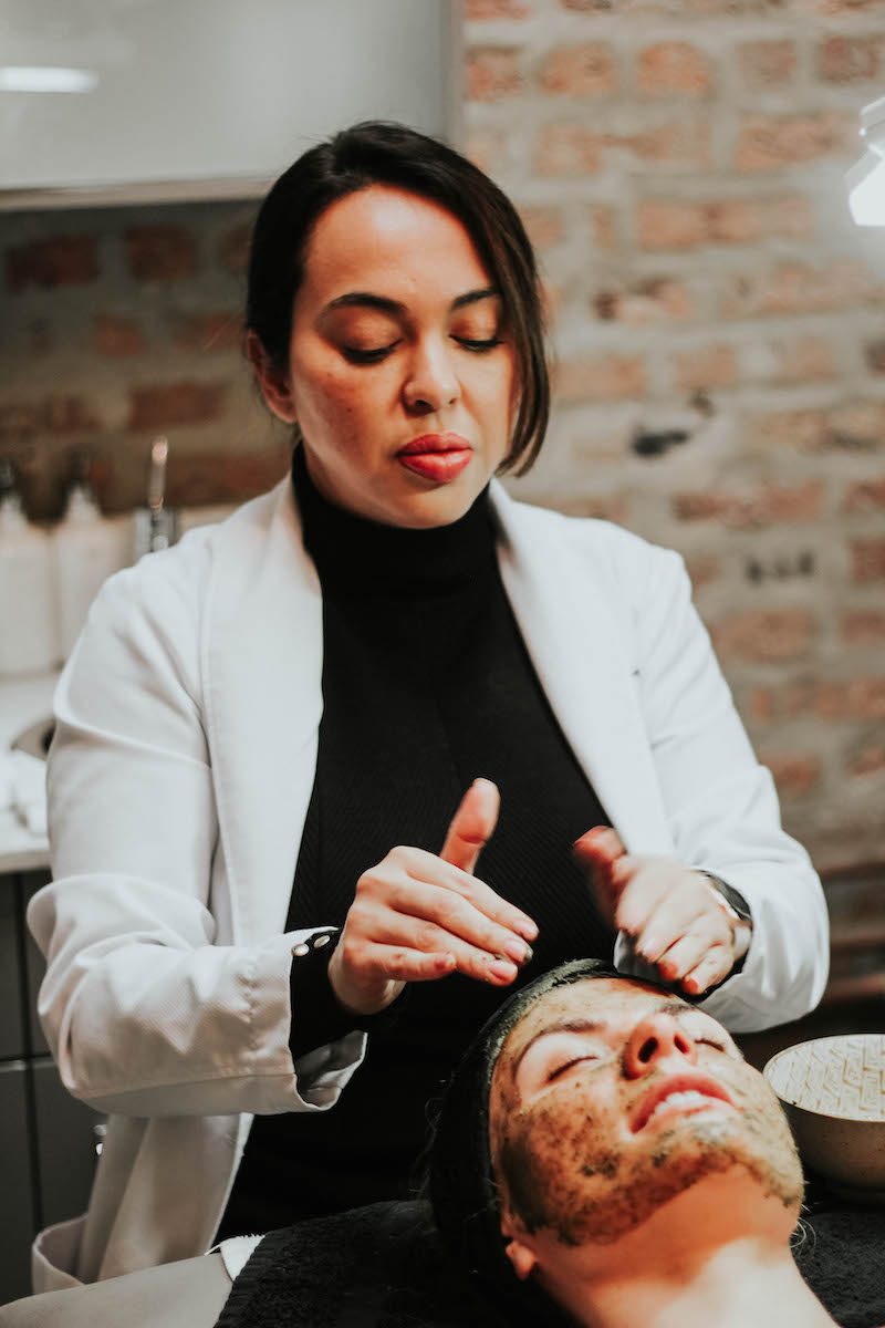 "Monika Dixon of Monika Dixon Public Relations experiences ""the green peel"" at SoLux Med Spa in River North with Angelica Anaya."