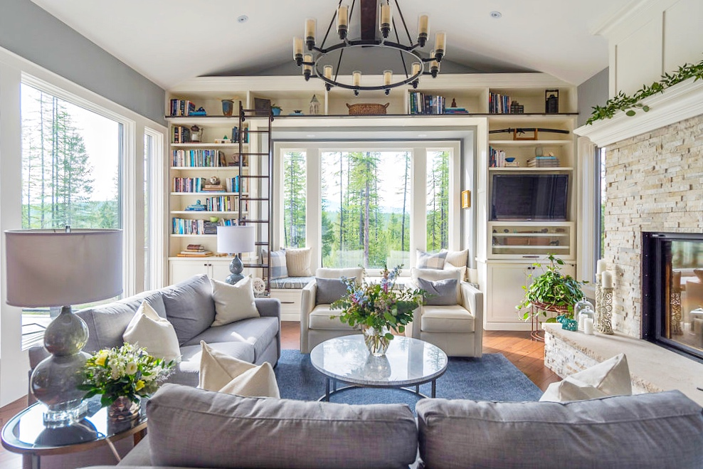 Living room- stone fireplace- bookcase with ladder- living room decor| Interior Designs by Adrienne | Cranbrook BC