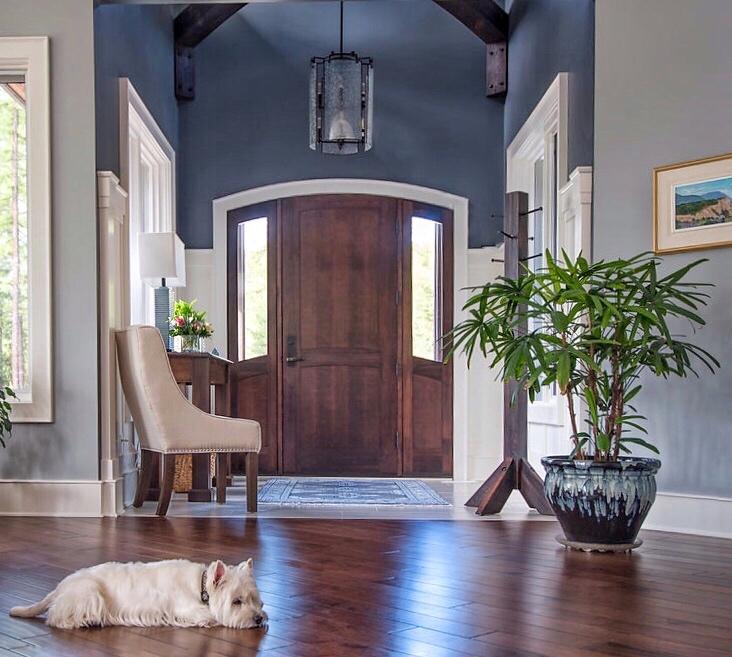 Interior-designs-by-adrienne-Cranbrook-BC-Foyer- timber frame beams- wood door- Chandelier- benjamin-moore-trout-gray