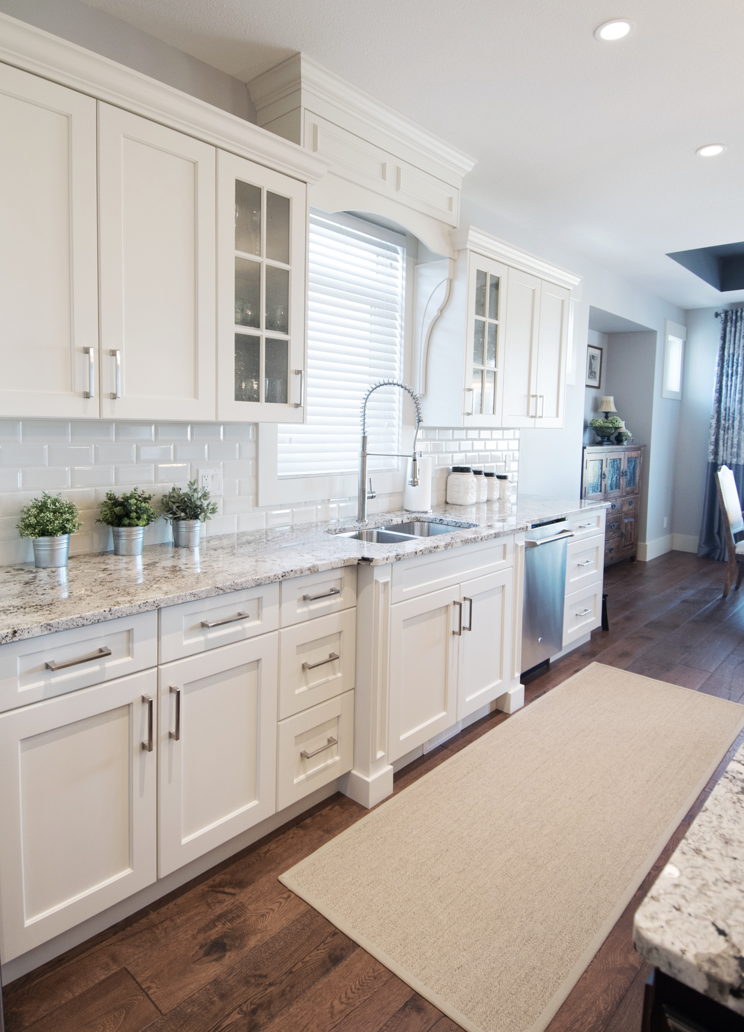 Traditional white shaer cabinets with beveled subway tile and alaska white granite, Interior Designs By Adrienne, Cranbrook BC