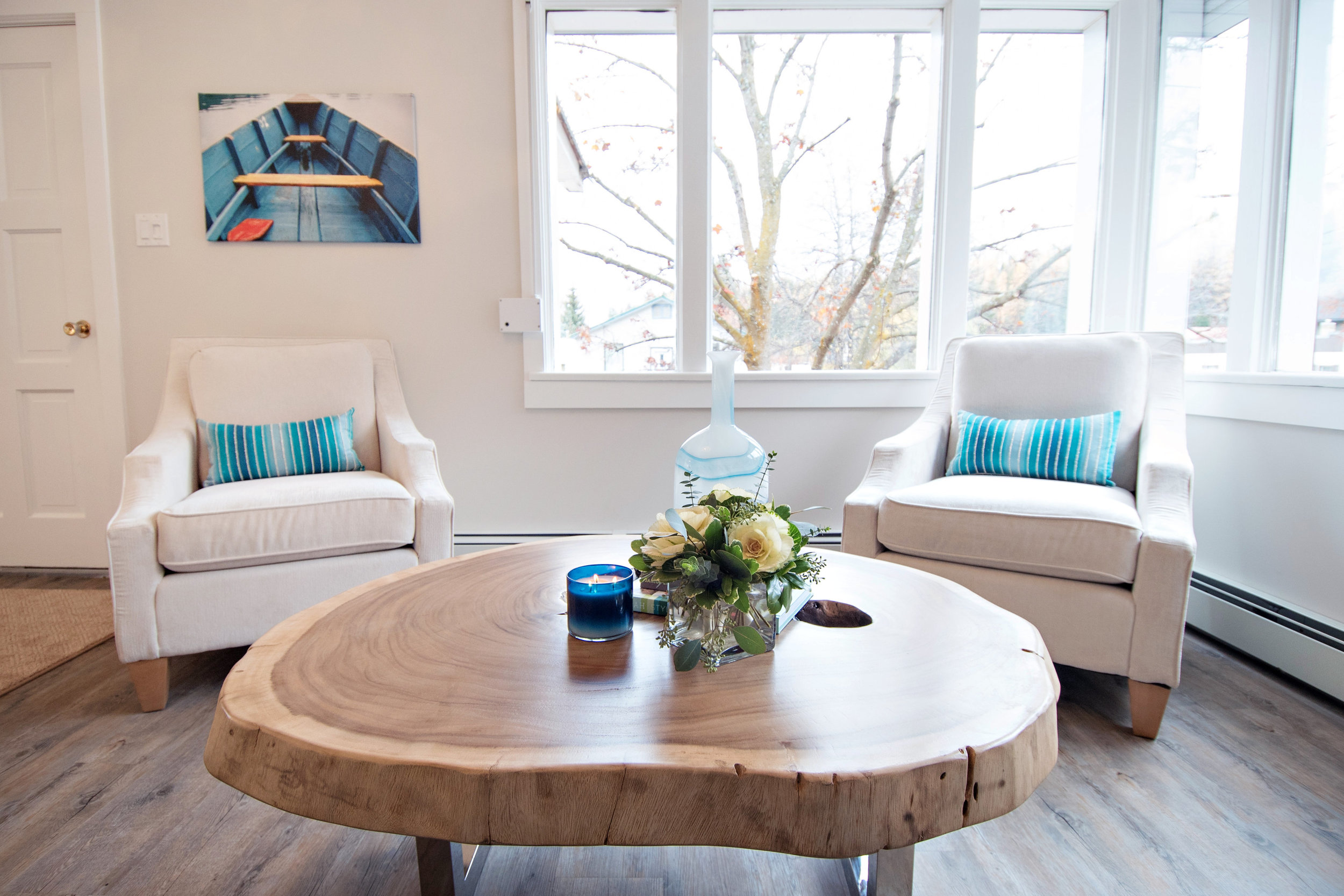 LAZY BOY CHAIRS, WOOD TABLE, LIVE EDGE TABLE, WHITE UPHOLSTERED CHAIRS, INTERIOR DESIGNS BY ADRIENNE, CRANBROOK BC