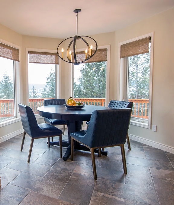 interior-designs-by-adrienne-cranbrook-bc-black-painted-table-black-gold-pendant-light-blue-leather-chairs