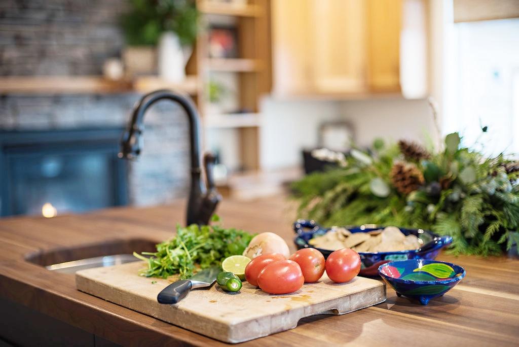 interior-designs-by-adrienne-cranbrook-bc-kitchen-island-black-walnut-counter-oil-rubbed-bronze-faucet