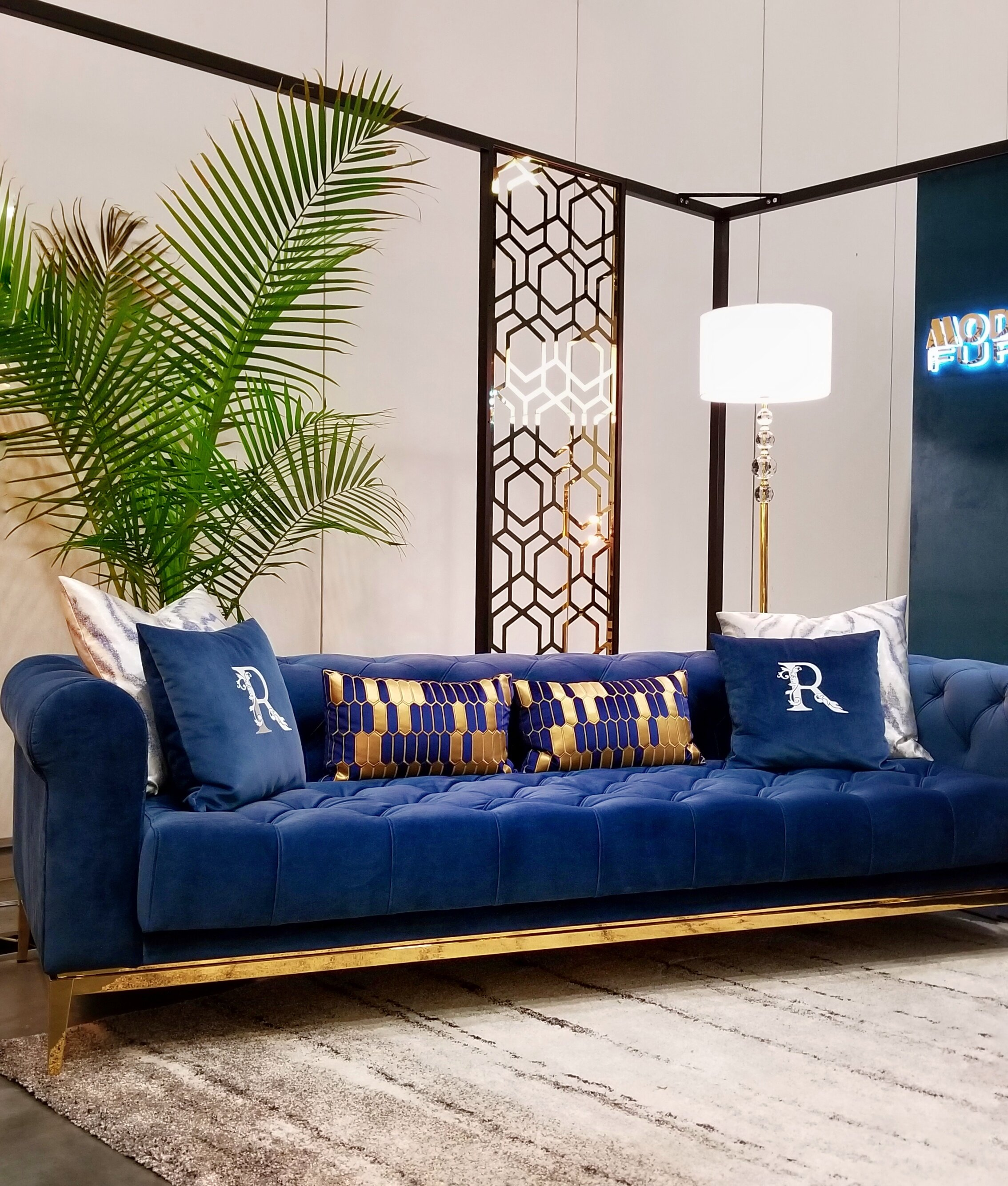 interior-designs-by-adrienne-cranbrook-bc-indigo-blue-sofa-blue-gold-pillows-floor-lamp-button-tufted